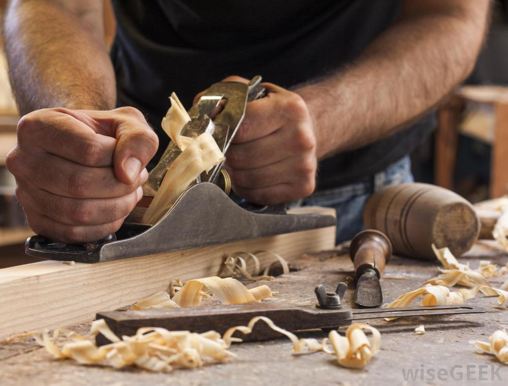 man-working-with-wood-with-shavings.jpg