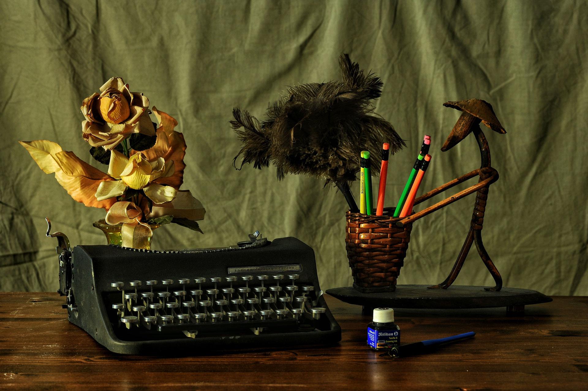 antique-desk-ink-dried-flowers-and-typewriter.jpg