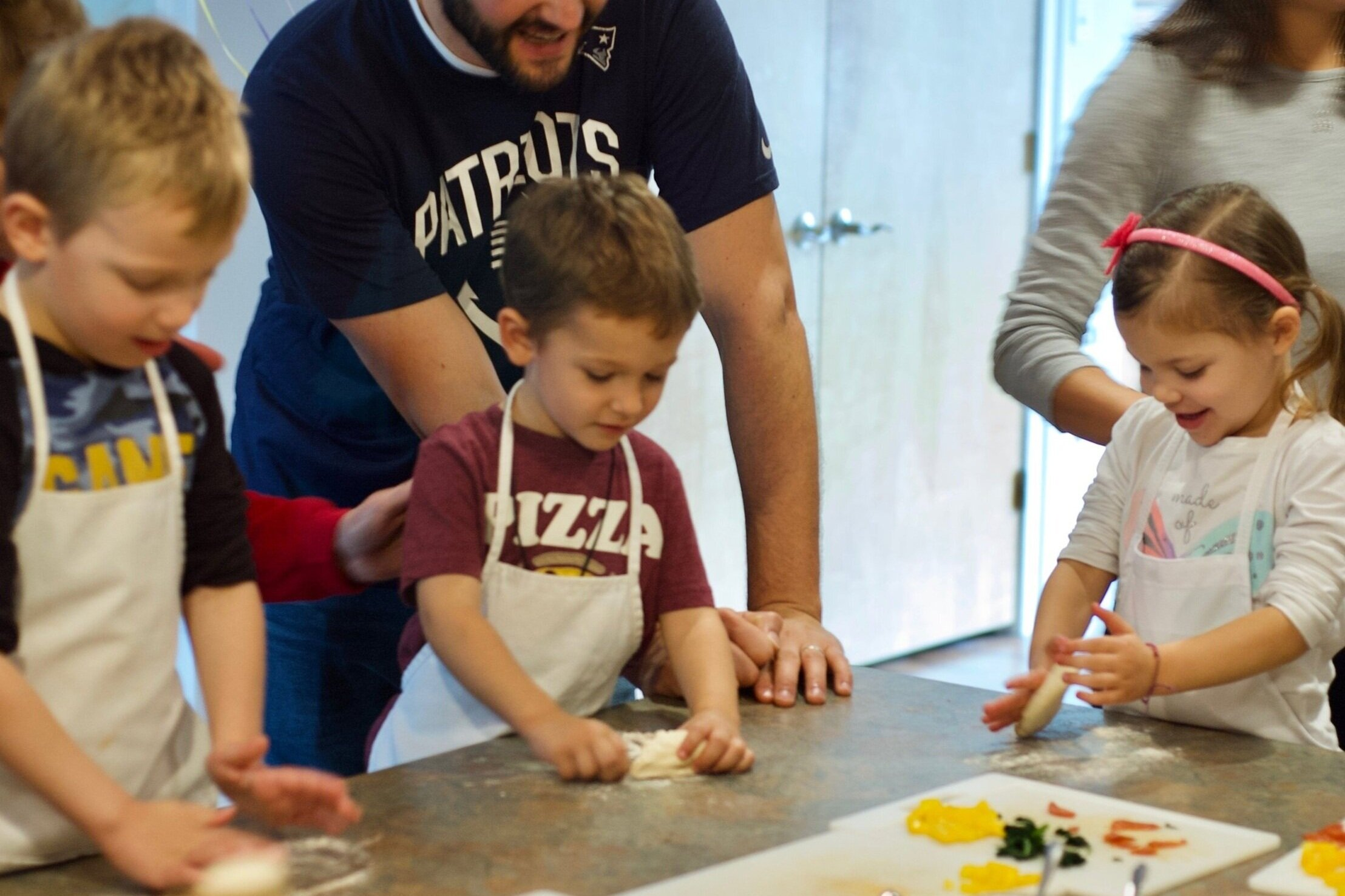 Make-Your-Own Pizza Birthday Party - Little chefs make personal pizzas, safely veggie-chopping, dough-rolling, & pizza-building.