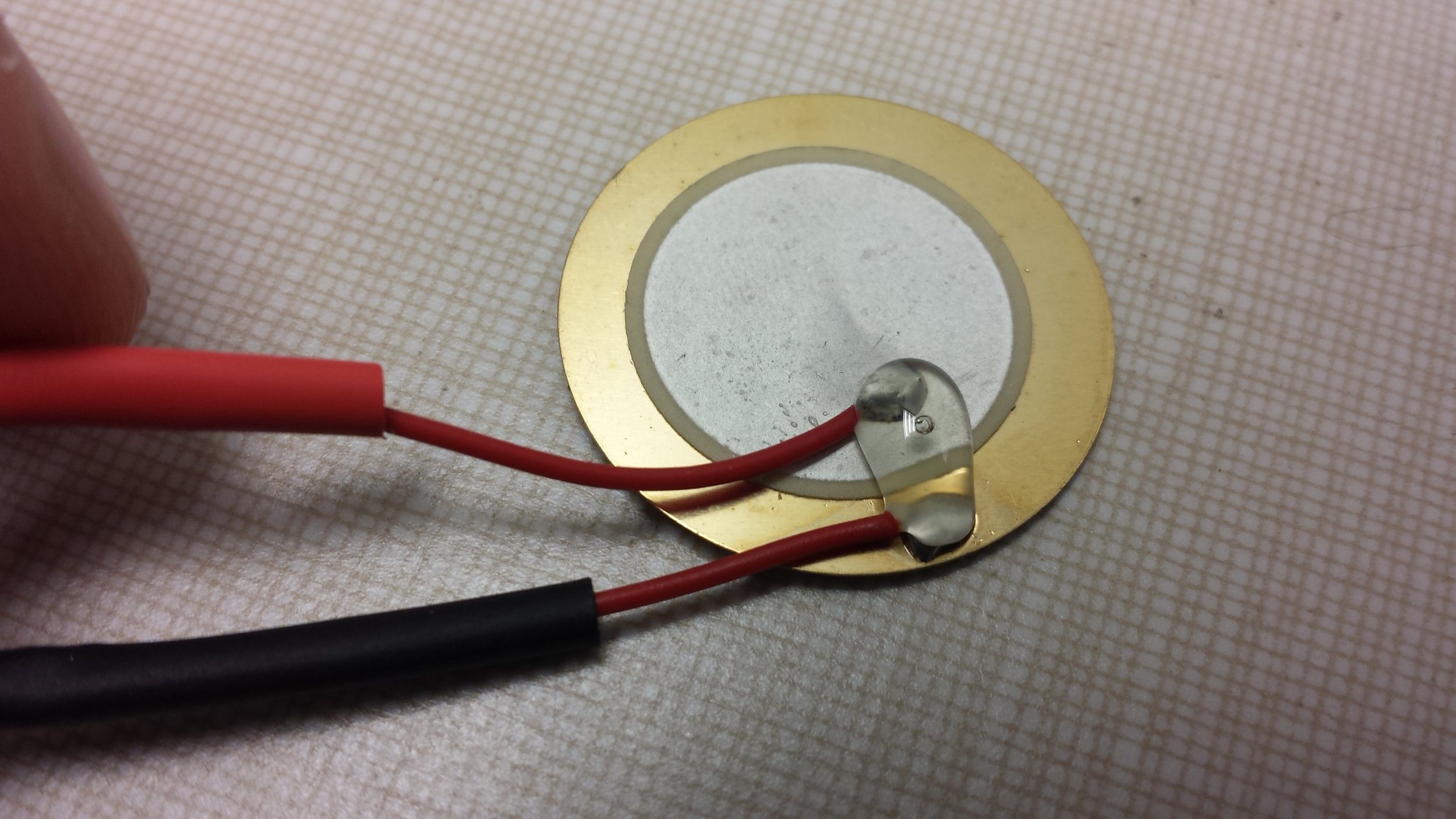 Hot glue between the two solder points also helped to prevent the ripping of wire