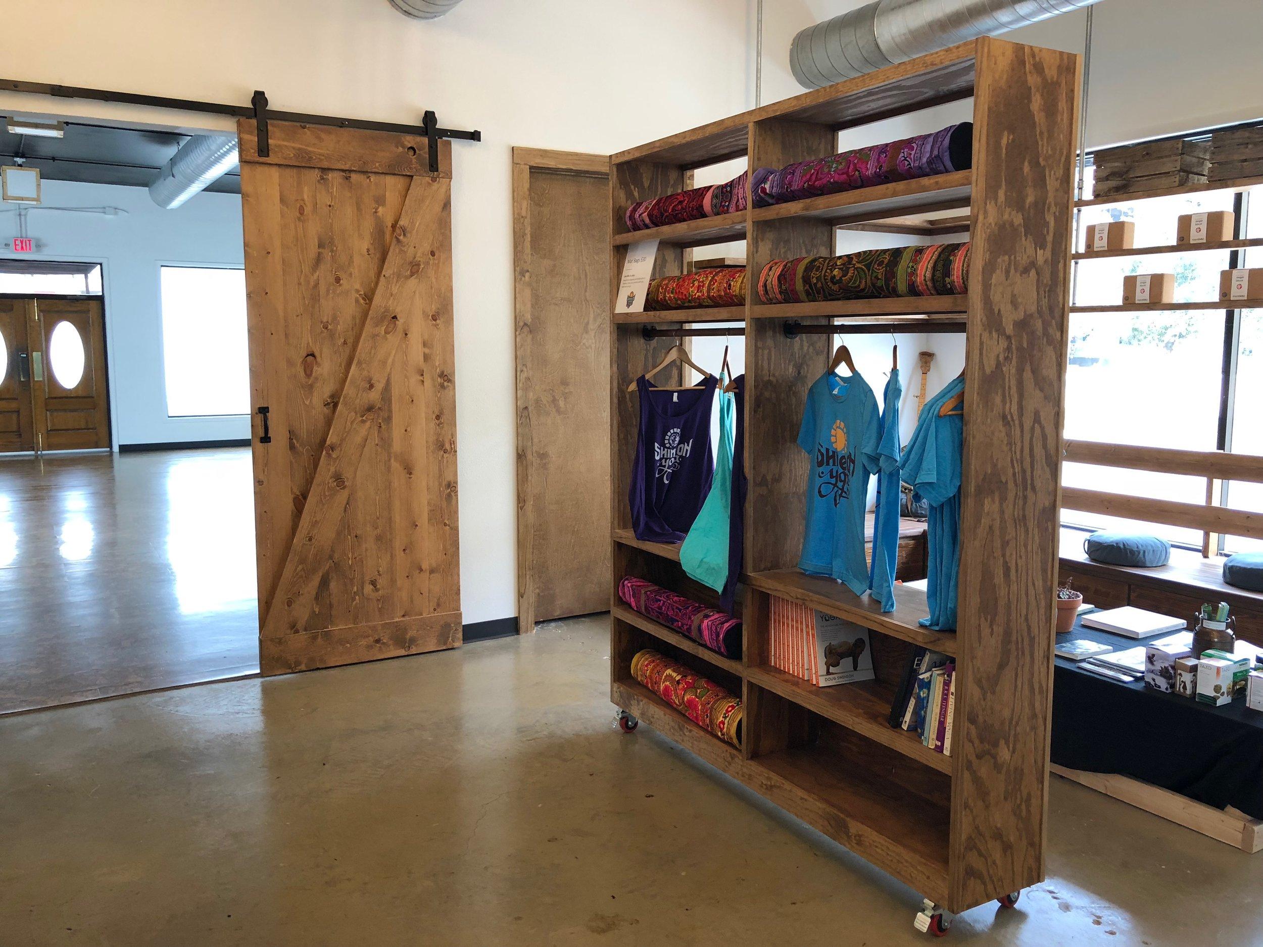 Merch shelf and sliding door into studio