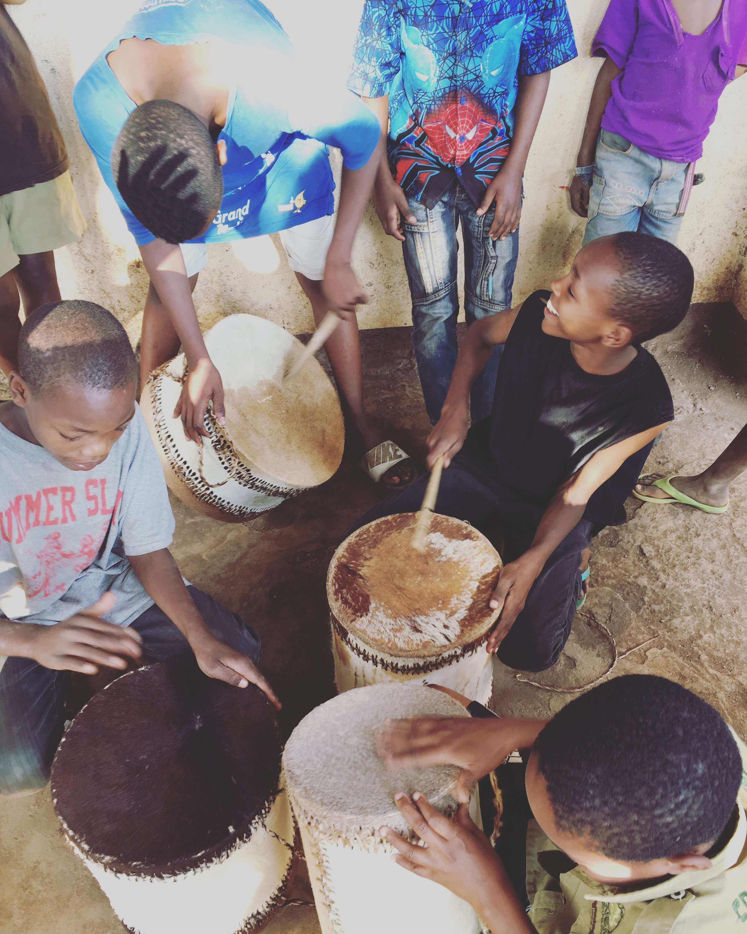 Some of the boys in the Music Club playing the African drums.
