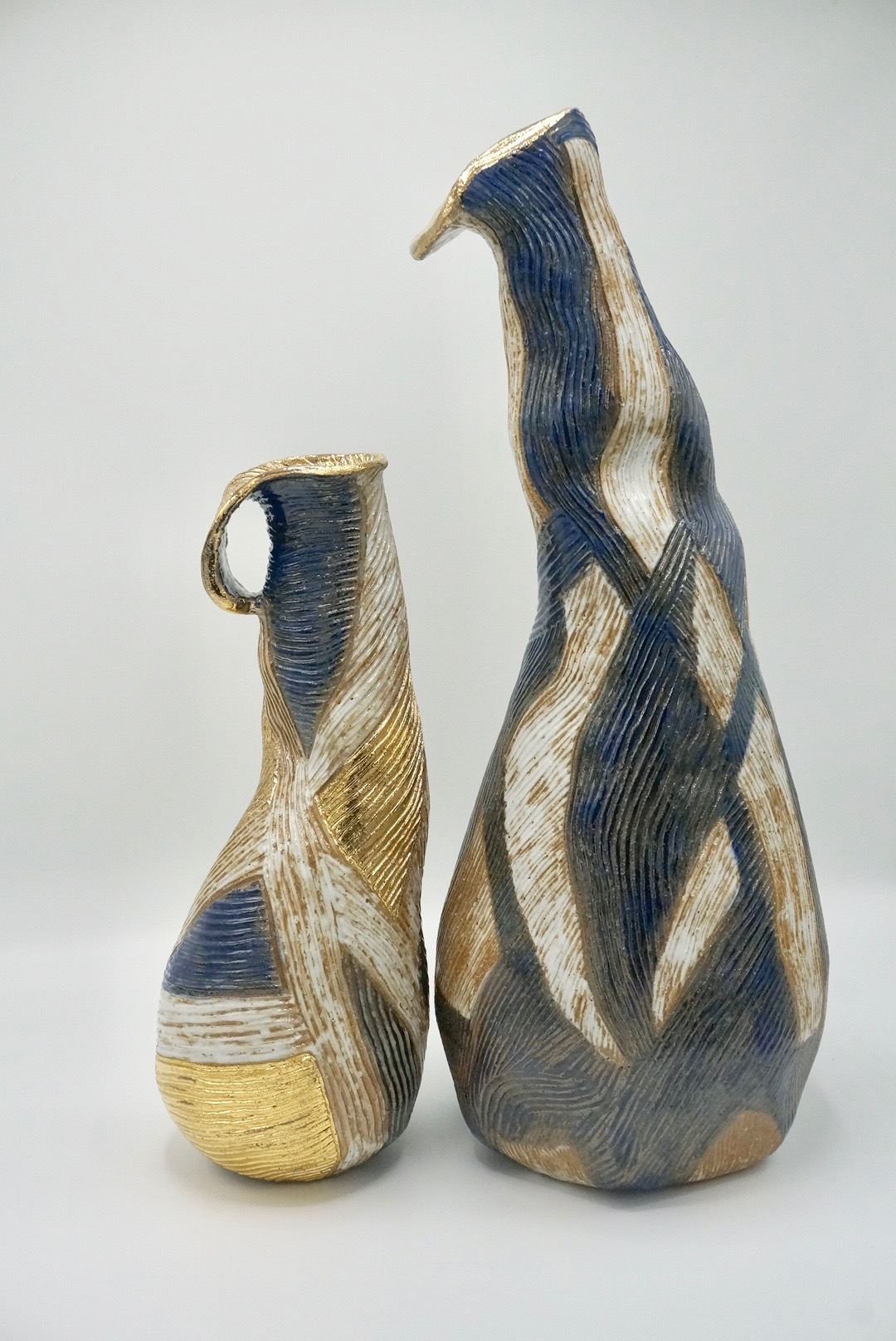 """Moko I & II Stoneware with Gold Luster  Small 5""""W x 14""""H Large 8""""W x 20"""" H   Inquire"""
