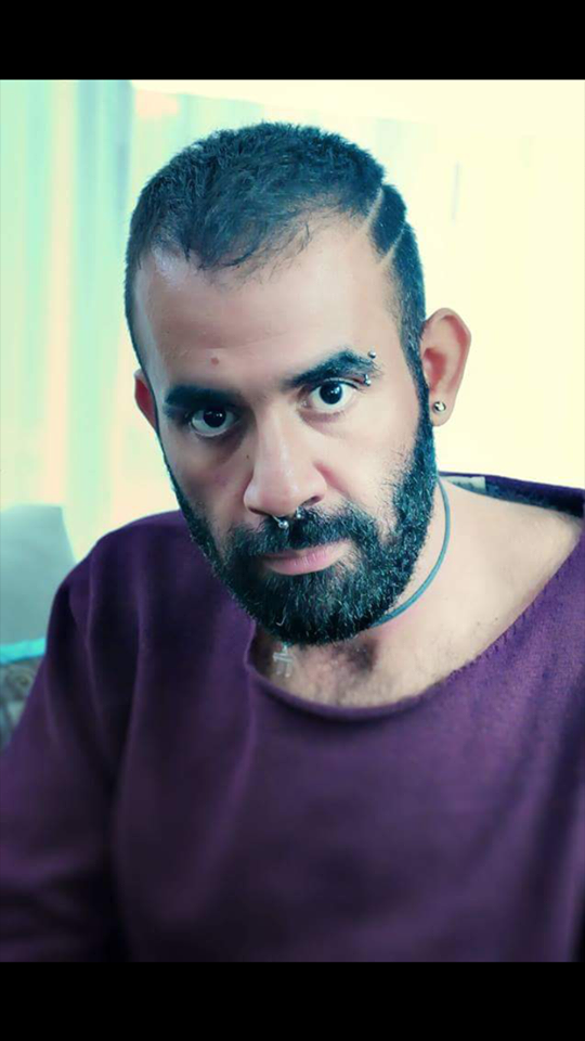 Elie Karam   Elie Karam (1987) fled Lebanon in 2015 and is currently working for queer refugee organisation Secret Garden. He is also a critical and enthusiastic programmer for IQMF, where he especially curated films on queer and middle-eastern topics.