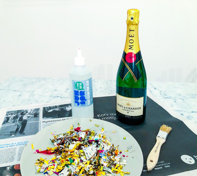 konfetti inklädd champagneflaska