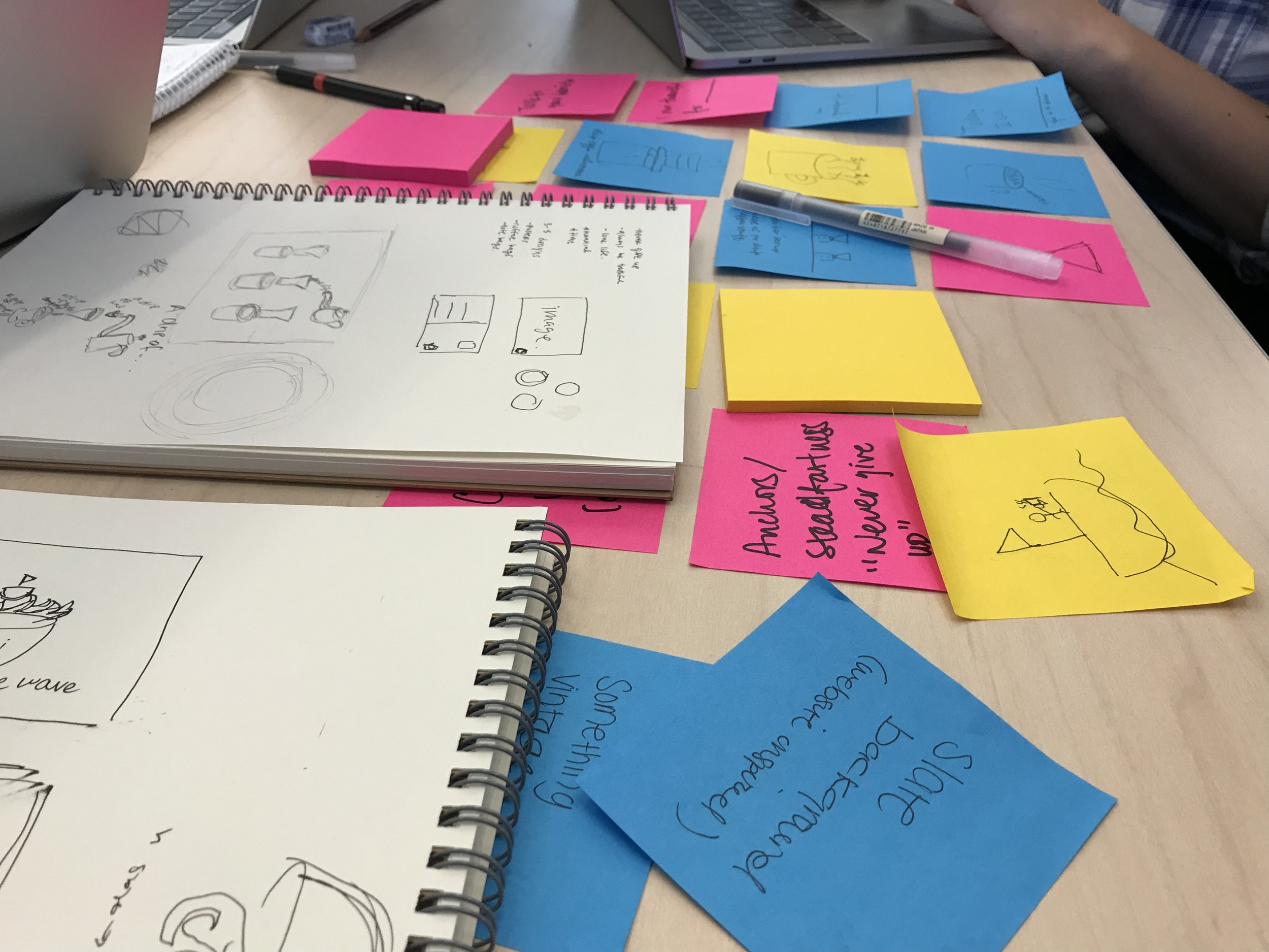 Hard at work merging our ideas and sketches into final designs.