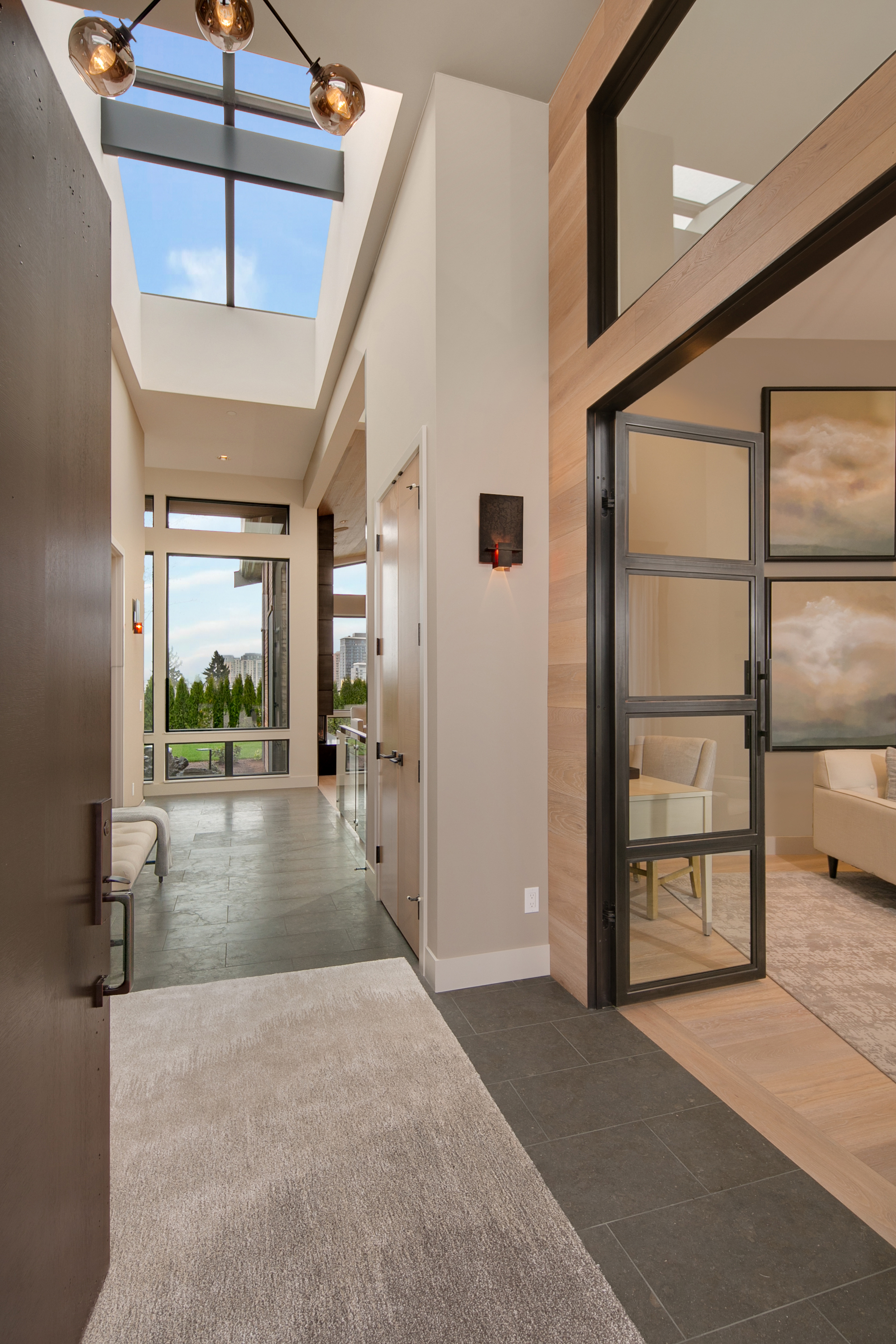 The soaring entrance with extensive skylights invite you into a space that is both modern & luxurious.