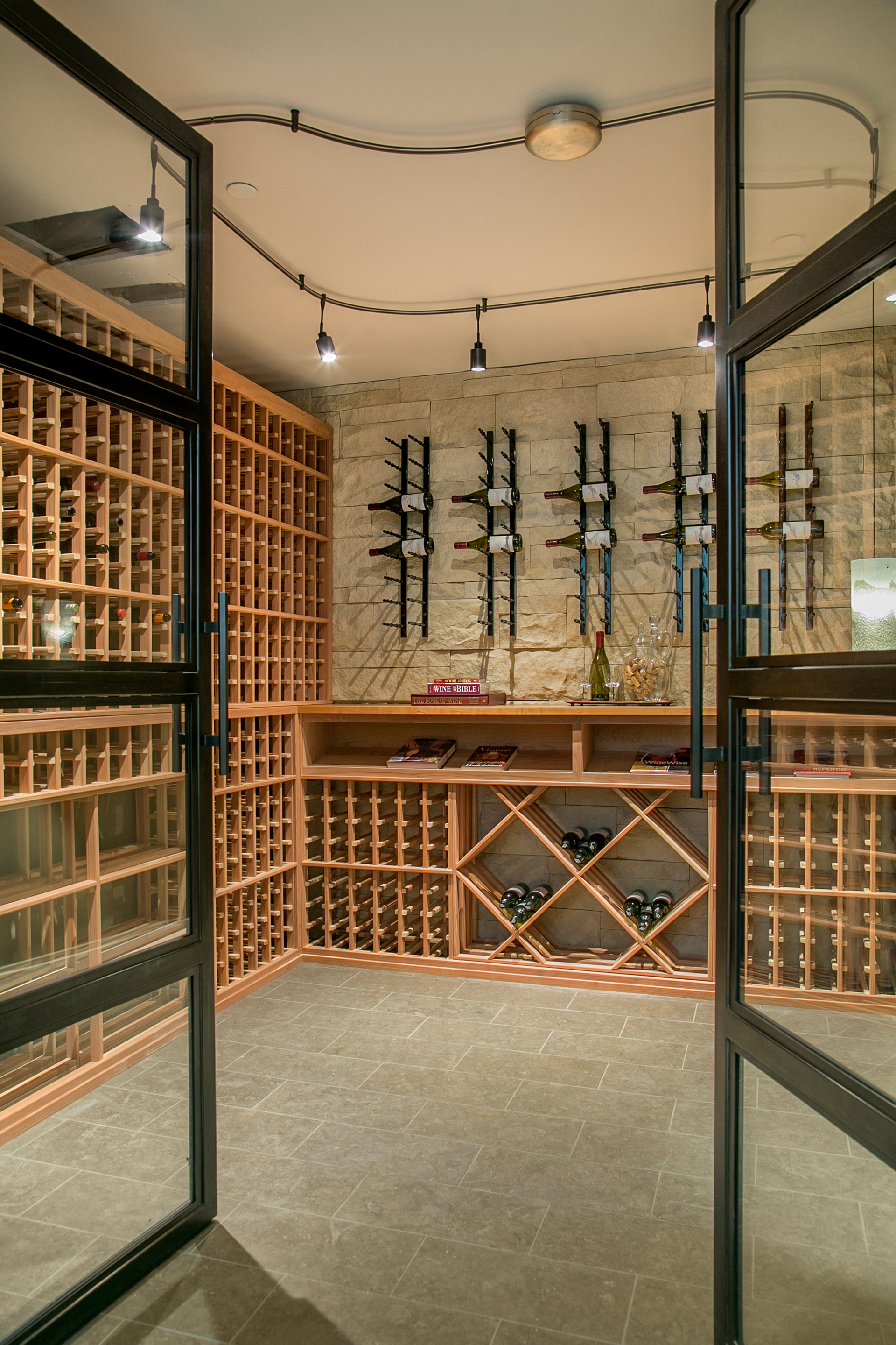 The wine cellar is less of a cellar and more of a tasting room; with space for more than 1,000 bottles & secured by custom steel and glass doors.
