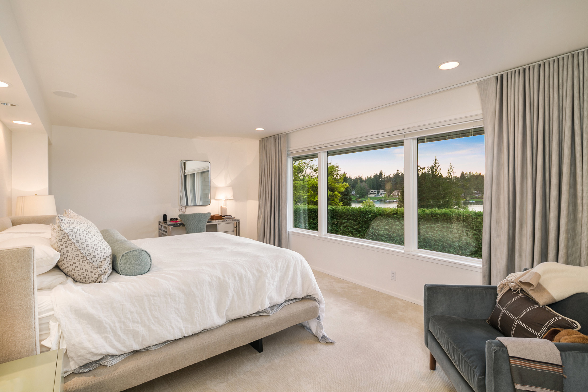 The main floor master suite is highlighted the protected lakefront views creating a space that is both luxurious and comfortable.