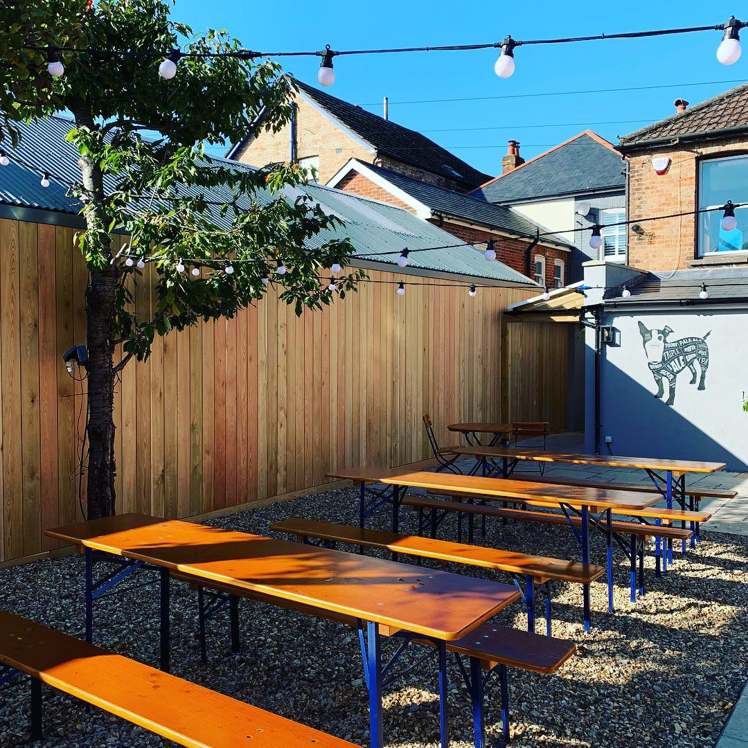 Craft beer bar & garden - Hidden off the main drag in Ashley Cross in a converted Victorian house, The Butcher's Dog Ashley Cross has two outside areas, a wood burner and a long bar area, so you can move around with the seasons...