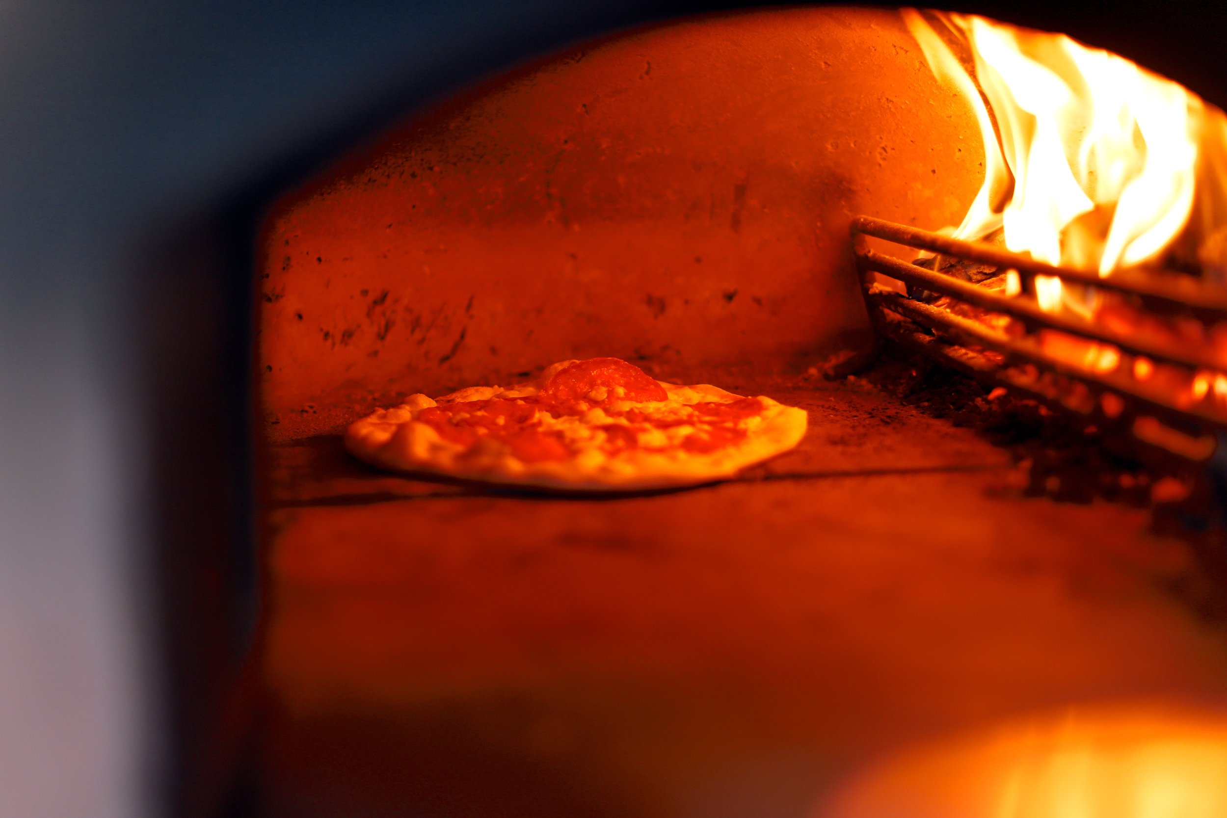Wood-Fired Pizza - Our friends at Flamin Grate popup in our kitchen Wednesday-Saturday, serving made-to-order pizza cooked in their wood-fired oven. Meat, veggie, vegan and gluten free options are all available here.