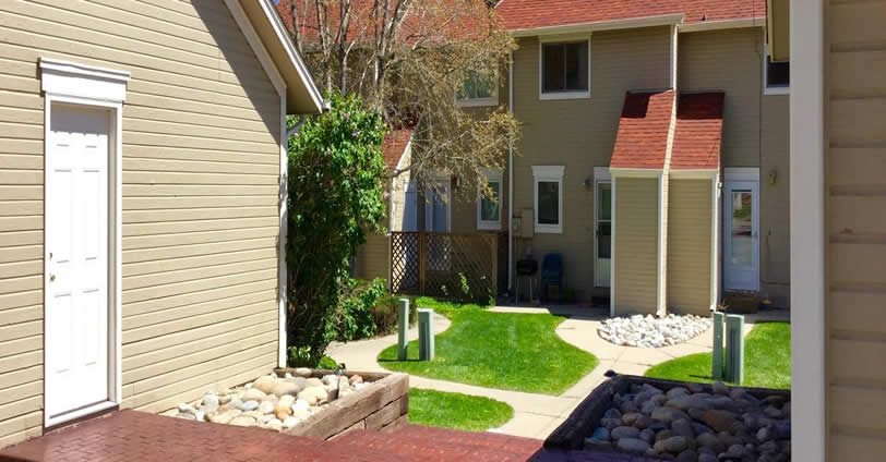 Weeping Willow Townhomes in Golden, Colorado feature a private back patio area that opens up to community walkways and lawn areas.