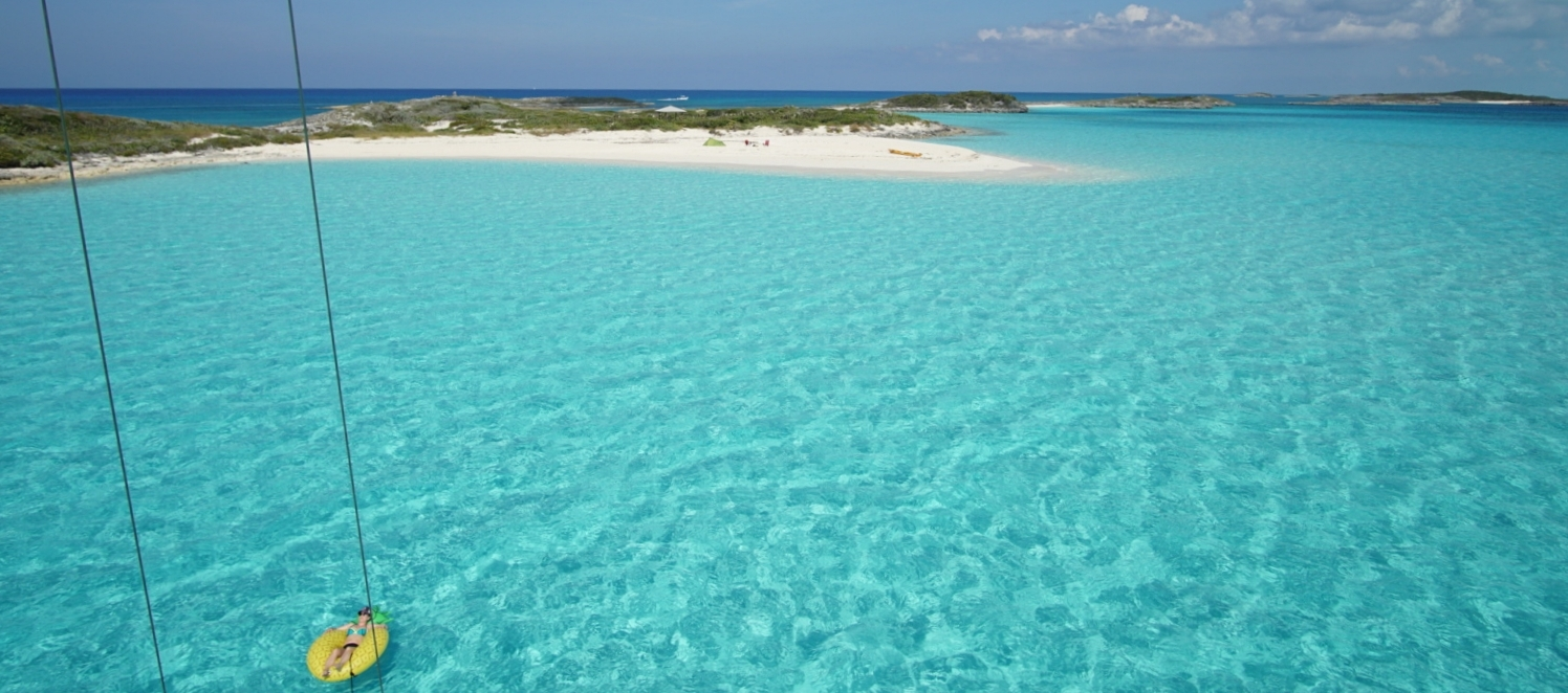 Swimming and Relaxing on a Saling Vacation in the Exumas Bahamas with Mojo