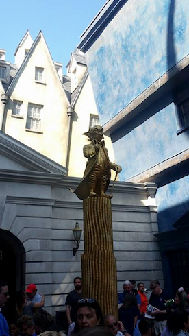 Harry Potter World's Gringott's Statue showing you all the coinage you can save with these tips.