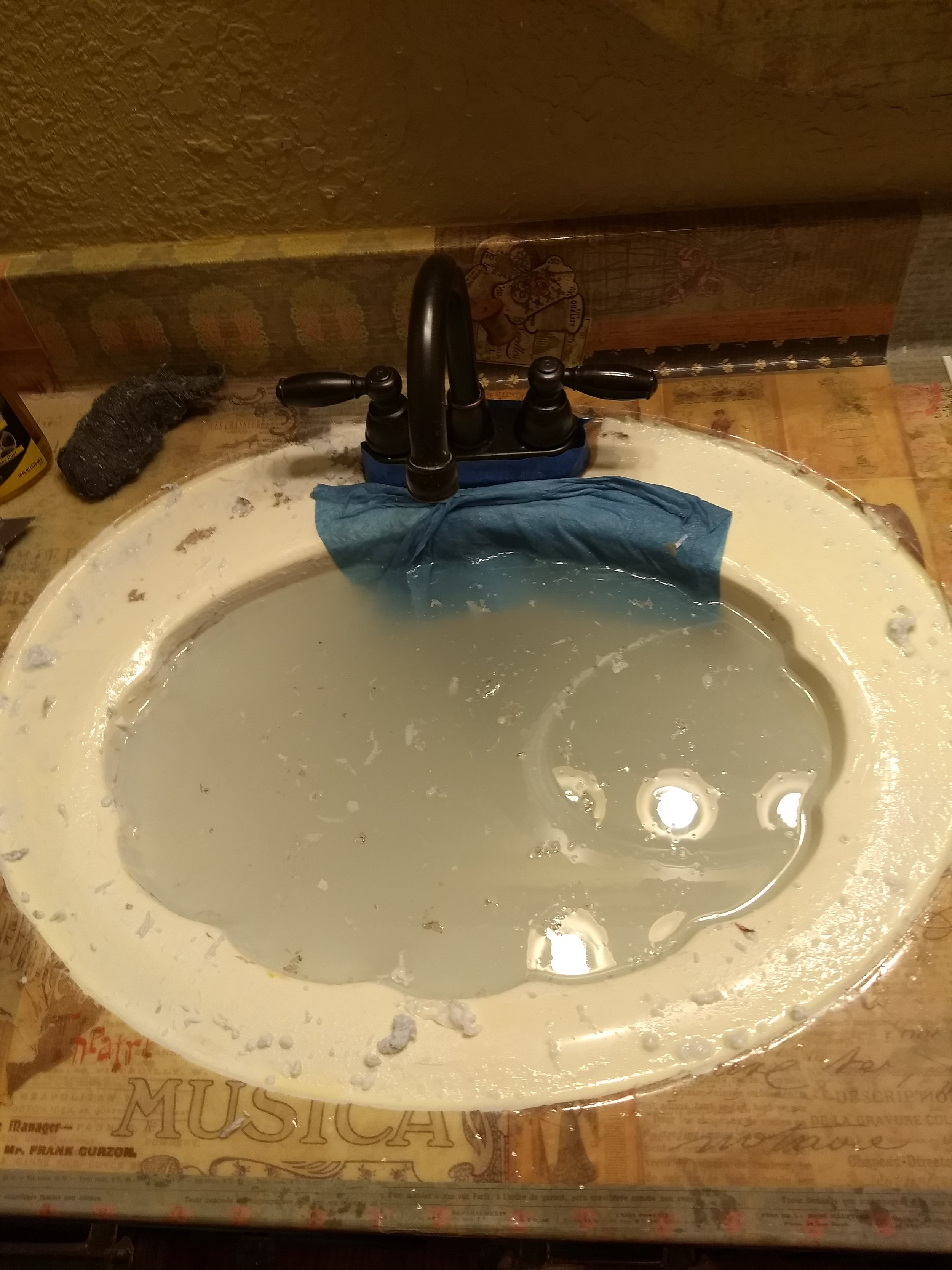 The sink soaking. Check out all the sticky paper pulp mess. Ugh!