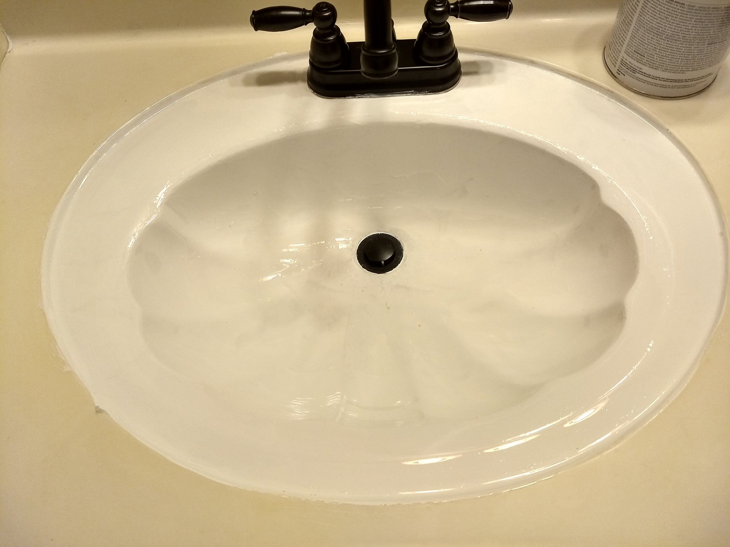 Here's the sink after the first coat of Tough As Tile.