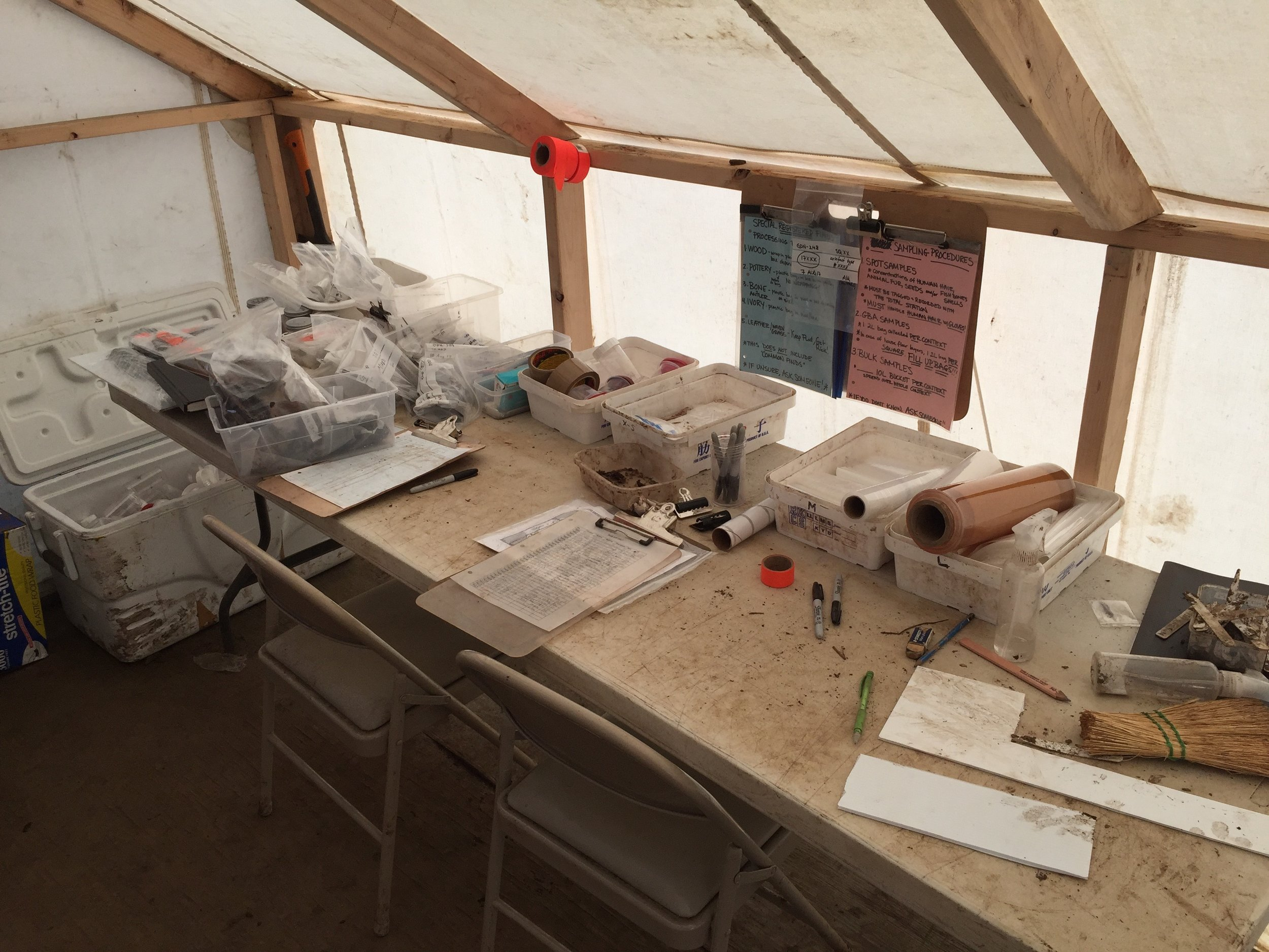 Our state of the art tent lab where all artifacts were processed with numbers corresponding to the square and context layer.  Each item would be flagged in situ.