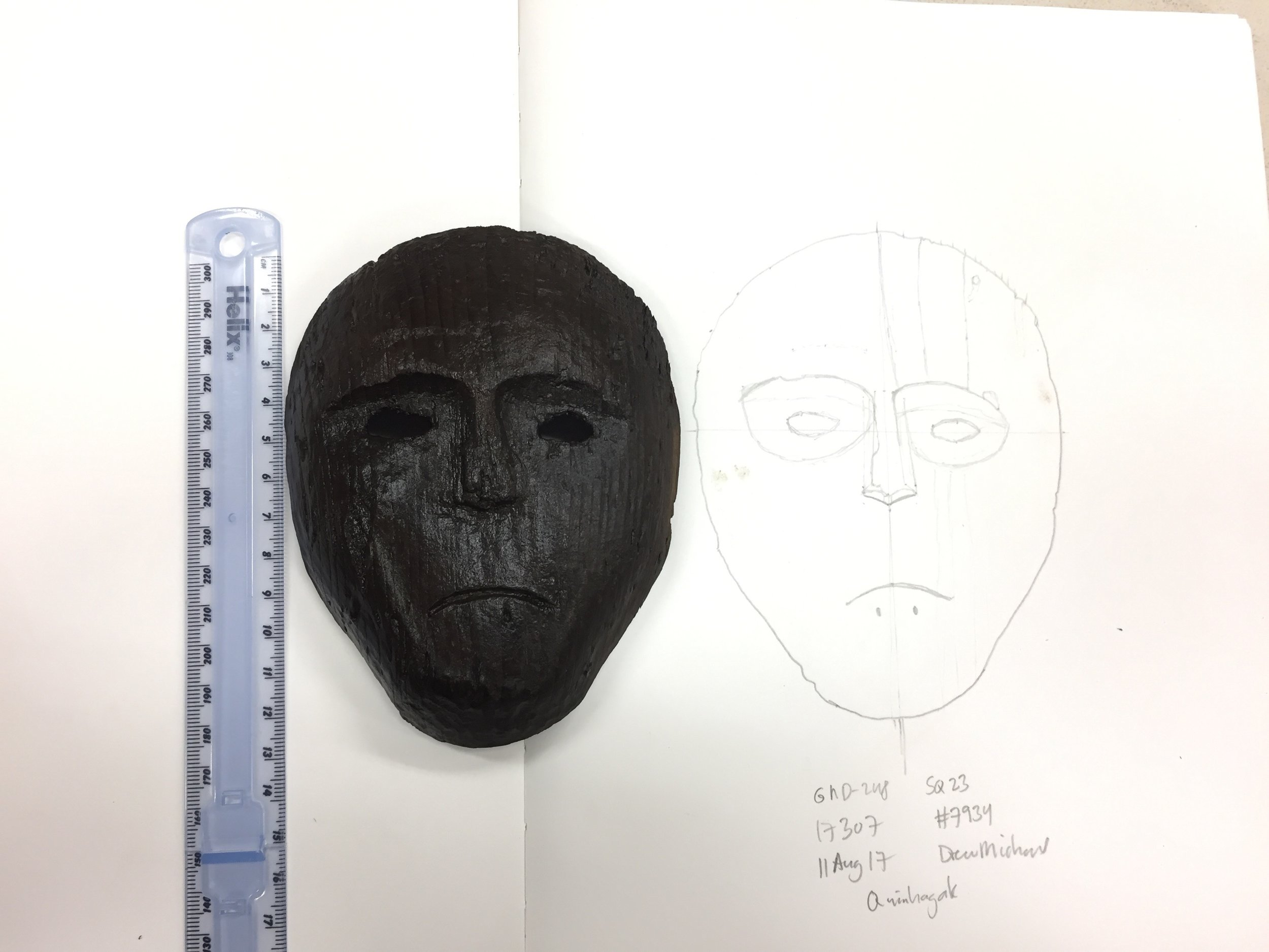 Drawing the mask found in situ after it has been cleaned and now documented.