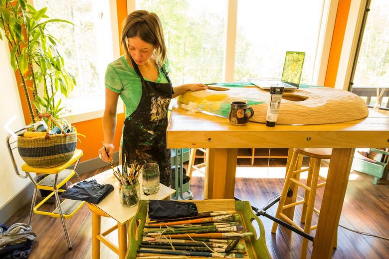 Elizabeth Ellis painting Fetal Alcohol Syndrome mask 2013. Photo by Loren Homes