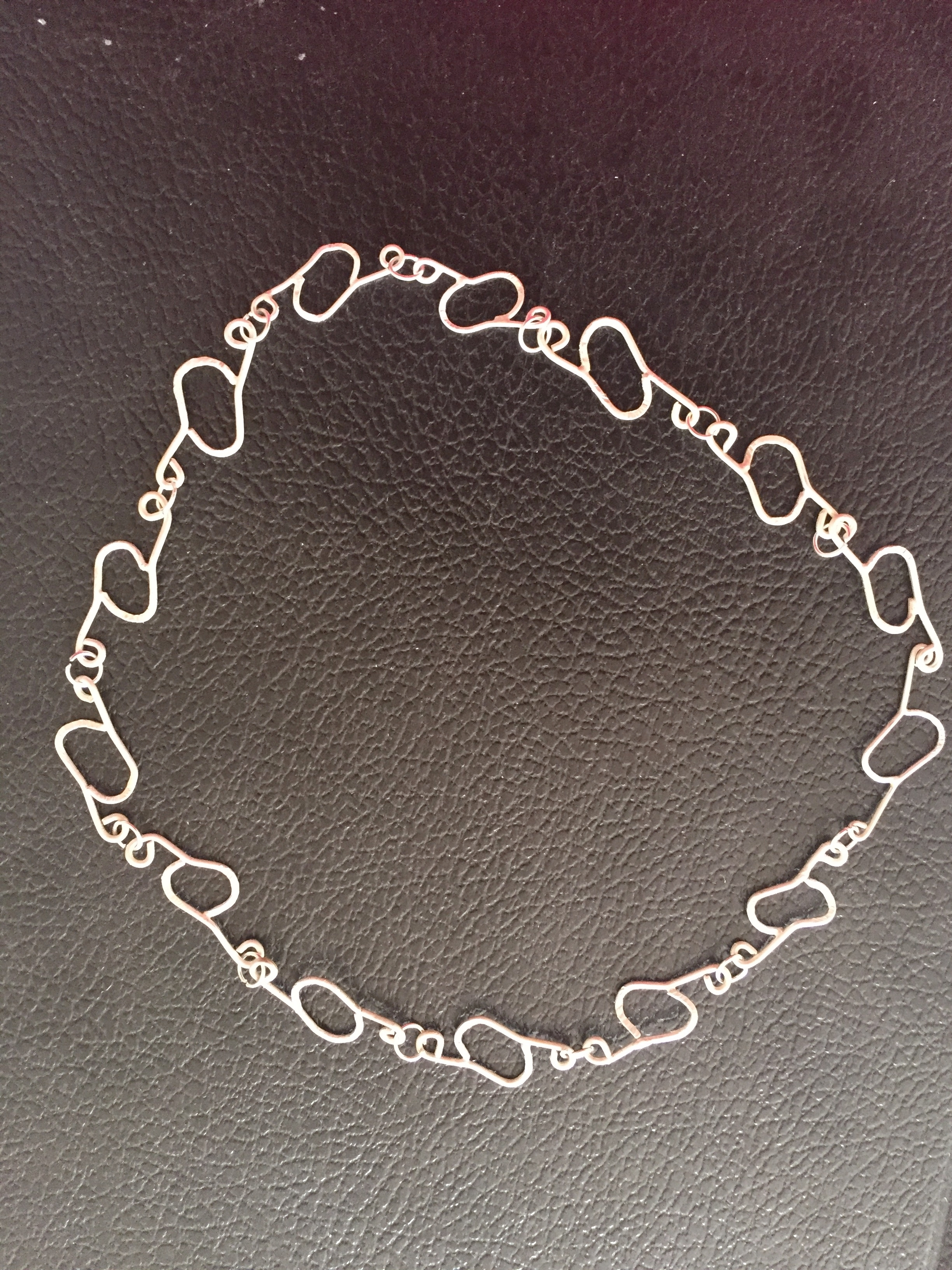 hand forged sterling silver chain, designed to be adjustable (contiguous links).