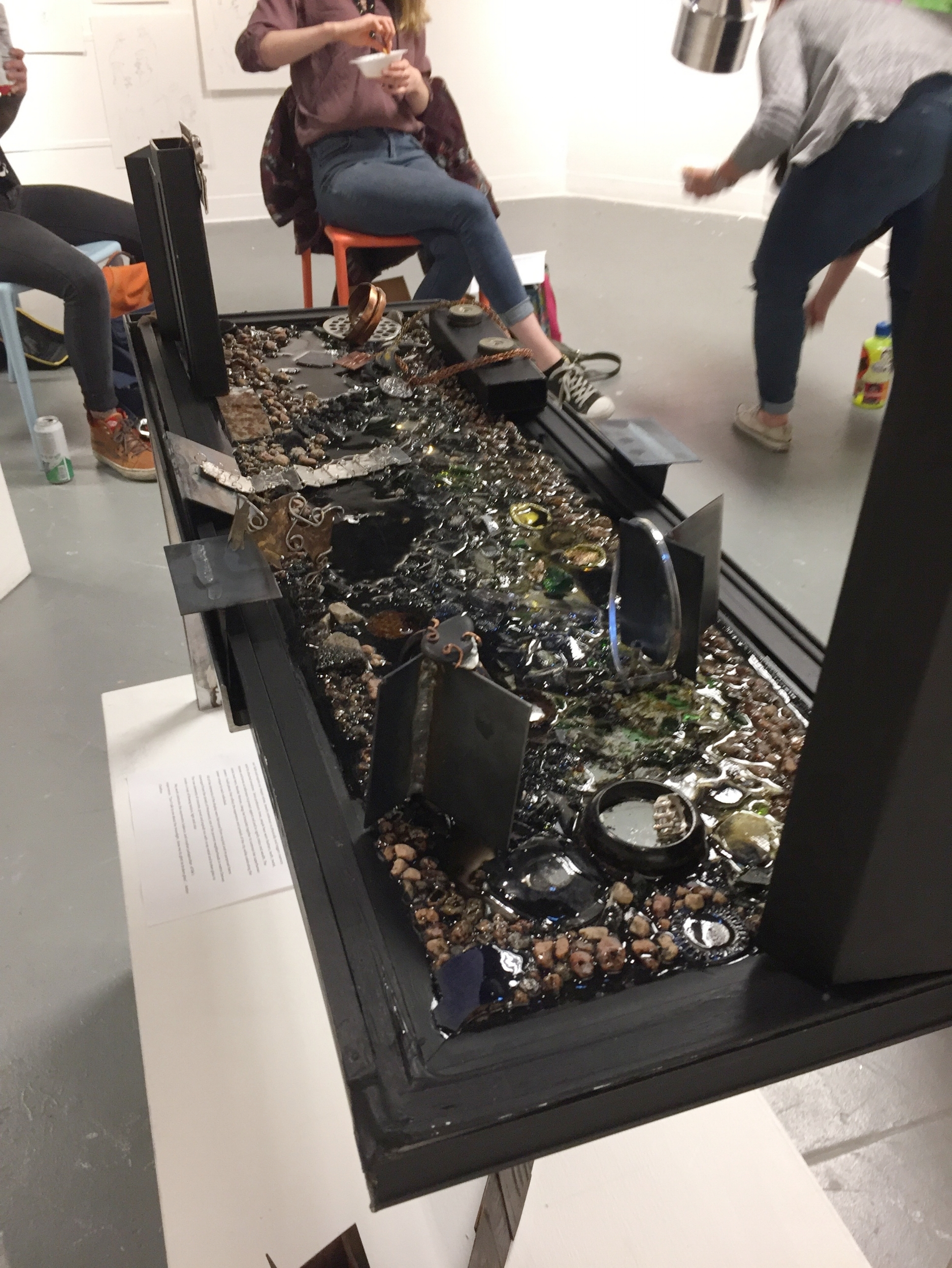 Gallery presentation of tableau, with jewelry pieces. The created environment adds impact to the jewelry and gives context to their design and fabrication methods and materials.
