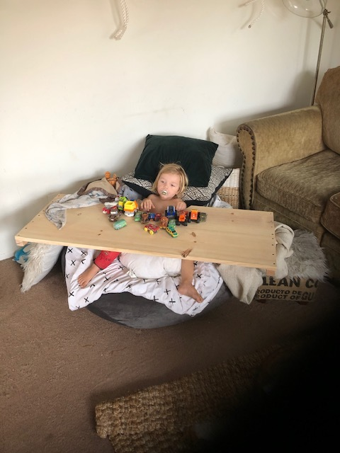- My number 1 tip I will leave you with….if you can, build them a table!!! I have no clue how Jay did this! Pretty sure it's just a slab of wood & he used his saw to cut a semi circle, sanded it, & voila! This will keep you SANE!!! And that baby entertained aaaallll day long!