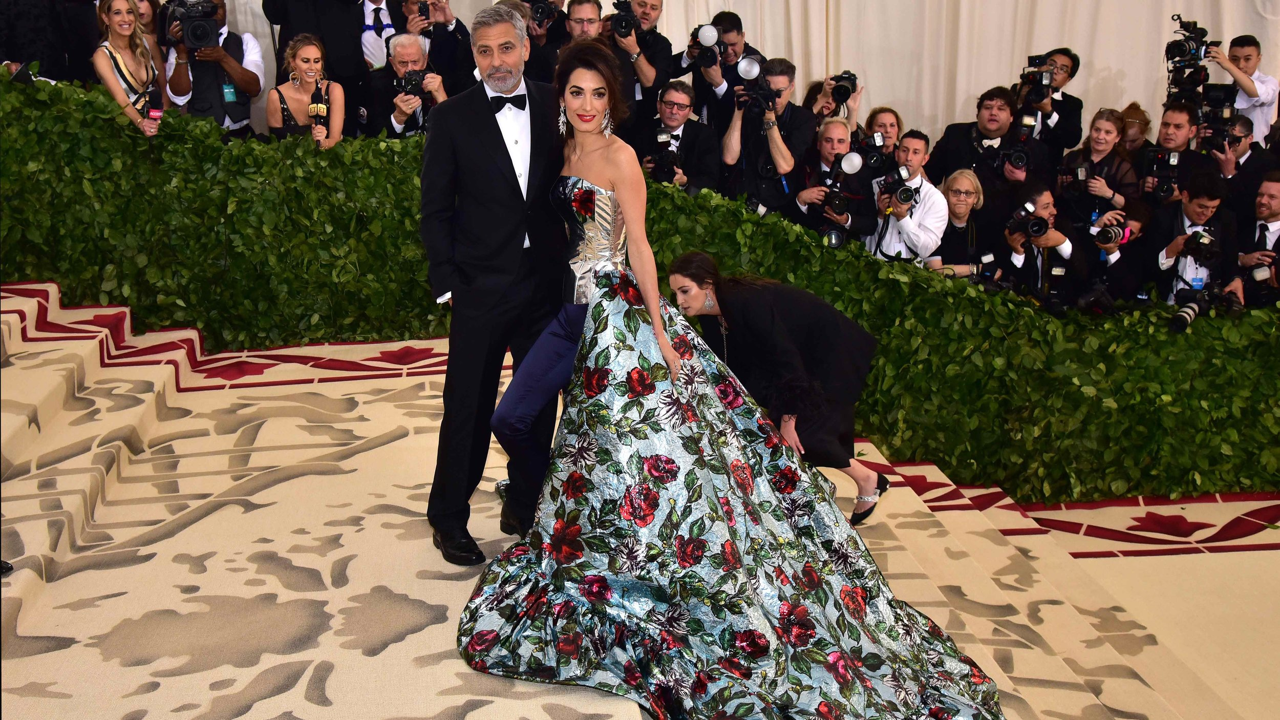 Amal and George Clooney -  MET Gala 2018 . Showcasing the double standards of men and women's Red Carpet fashion. Image: Getty Images.