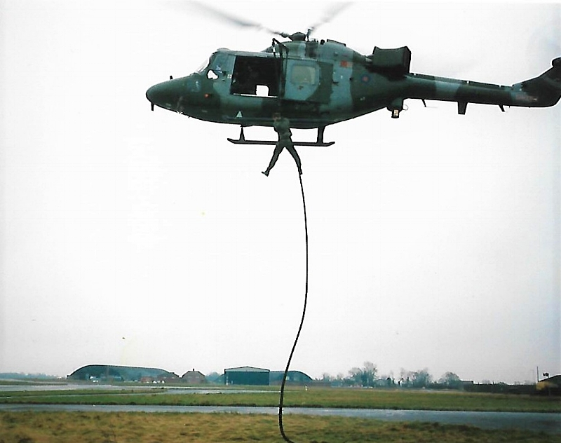 Jamie fast roping out of a Lynx Helicopter