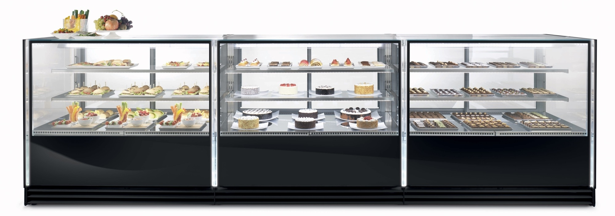 VIK   All new complete and versatile line of refrigerated showcases properly studied for pastry, confectionery and gastronomy available in different heights. Hygienic, energy-saving double-glazed sliding doors.