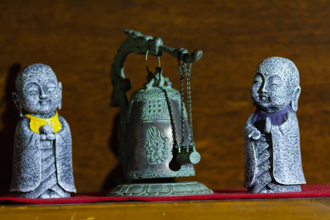 Ojizo statues and a bell. Photographer credit to John Cape Photography at johncapephotography.com