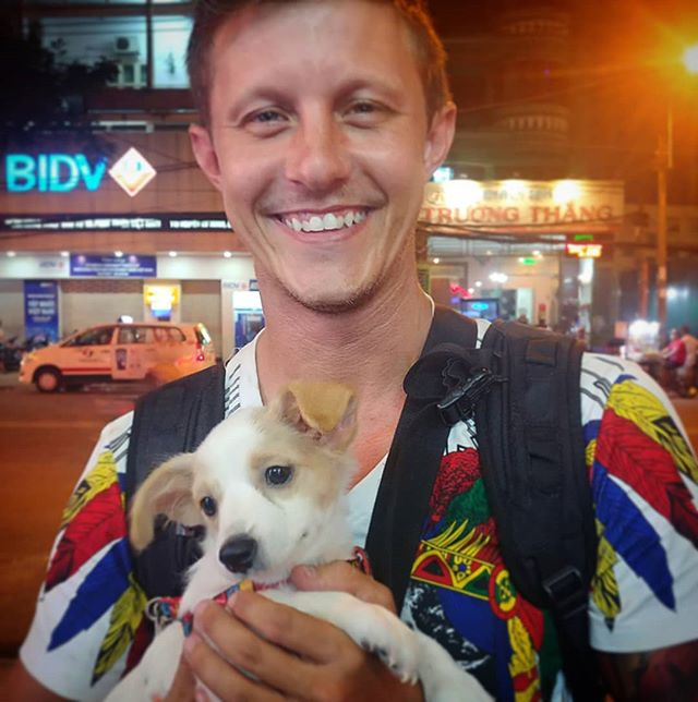 Everyone cheeses too hard when they hold a puppy. This little fella was in Ho Chi Minh.