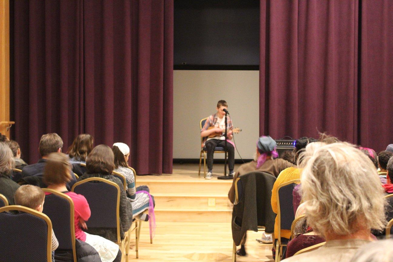 A Hazen student performs an original song