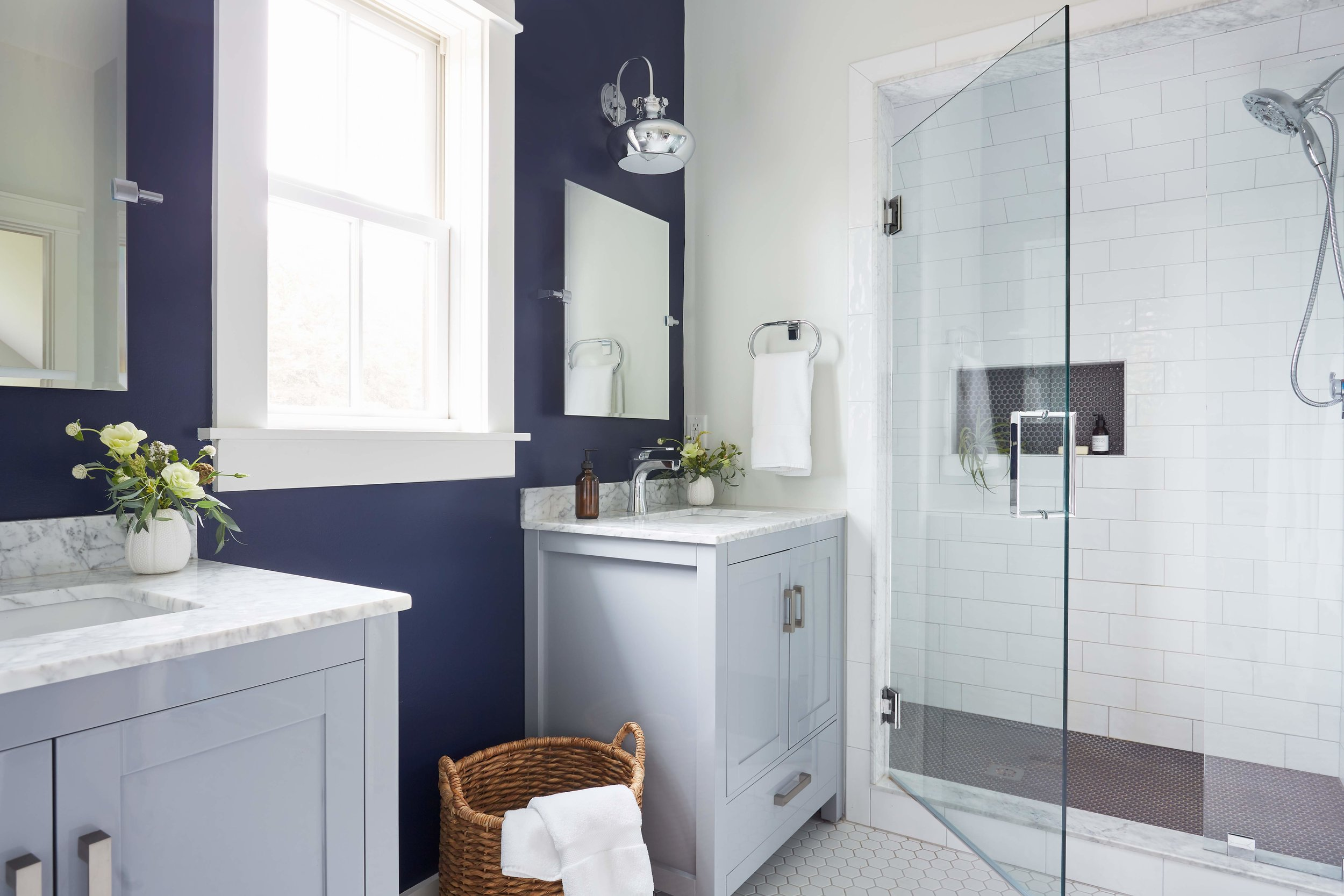 New bathroom designed as second master suite with navy accent wall.