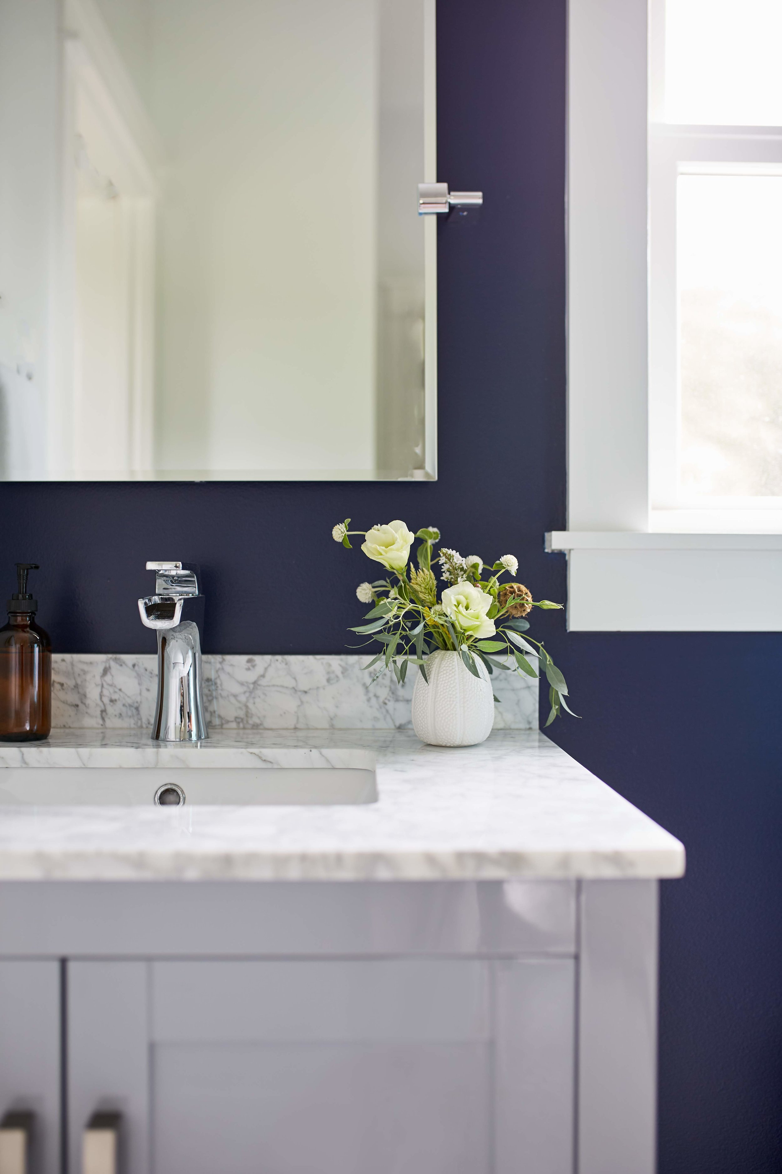 Vanity detail with navy accent wall.
