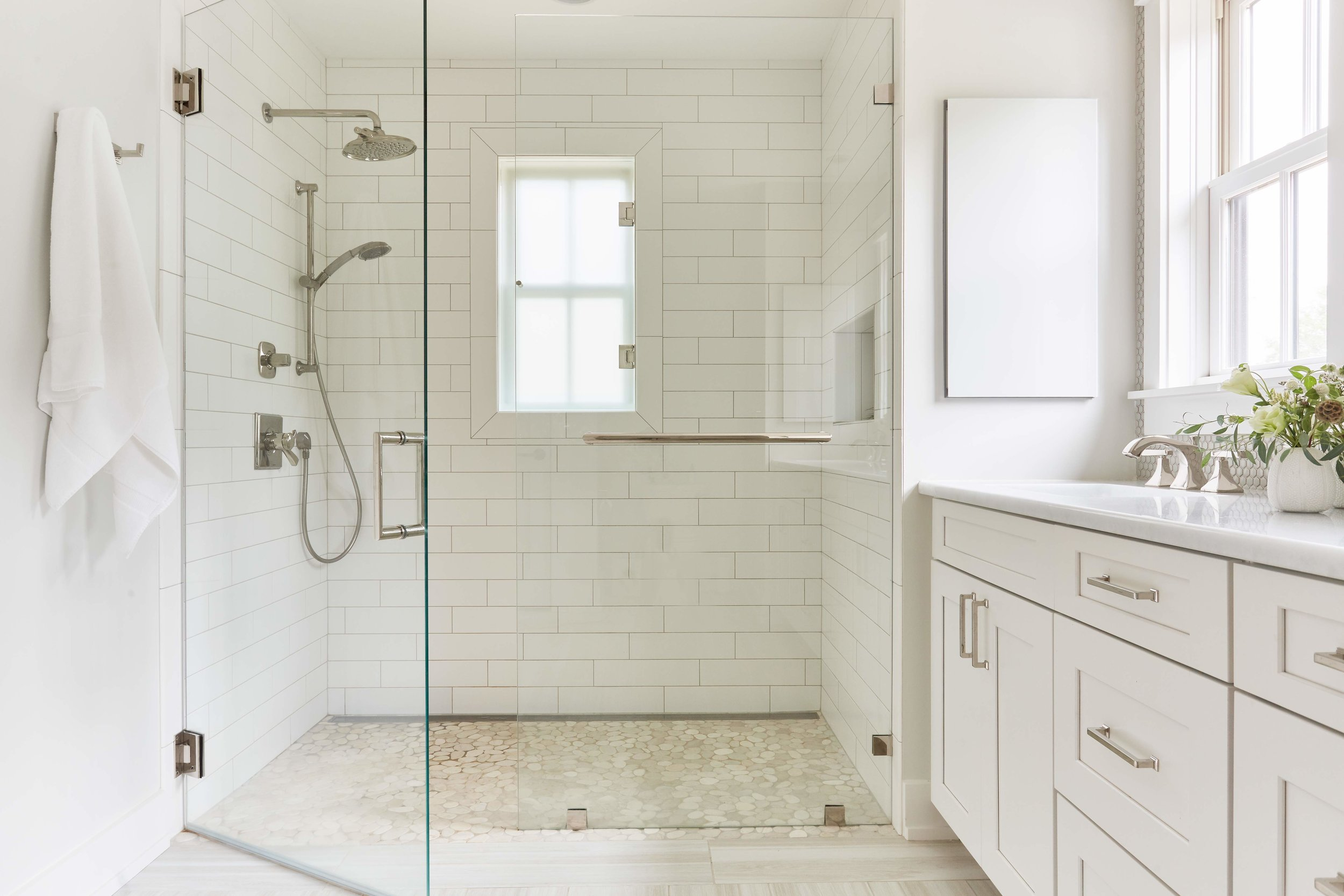Zero-entry shower in first floor bathroom allows owners to age in place.