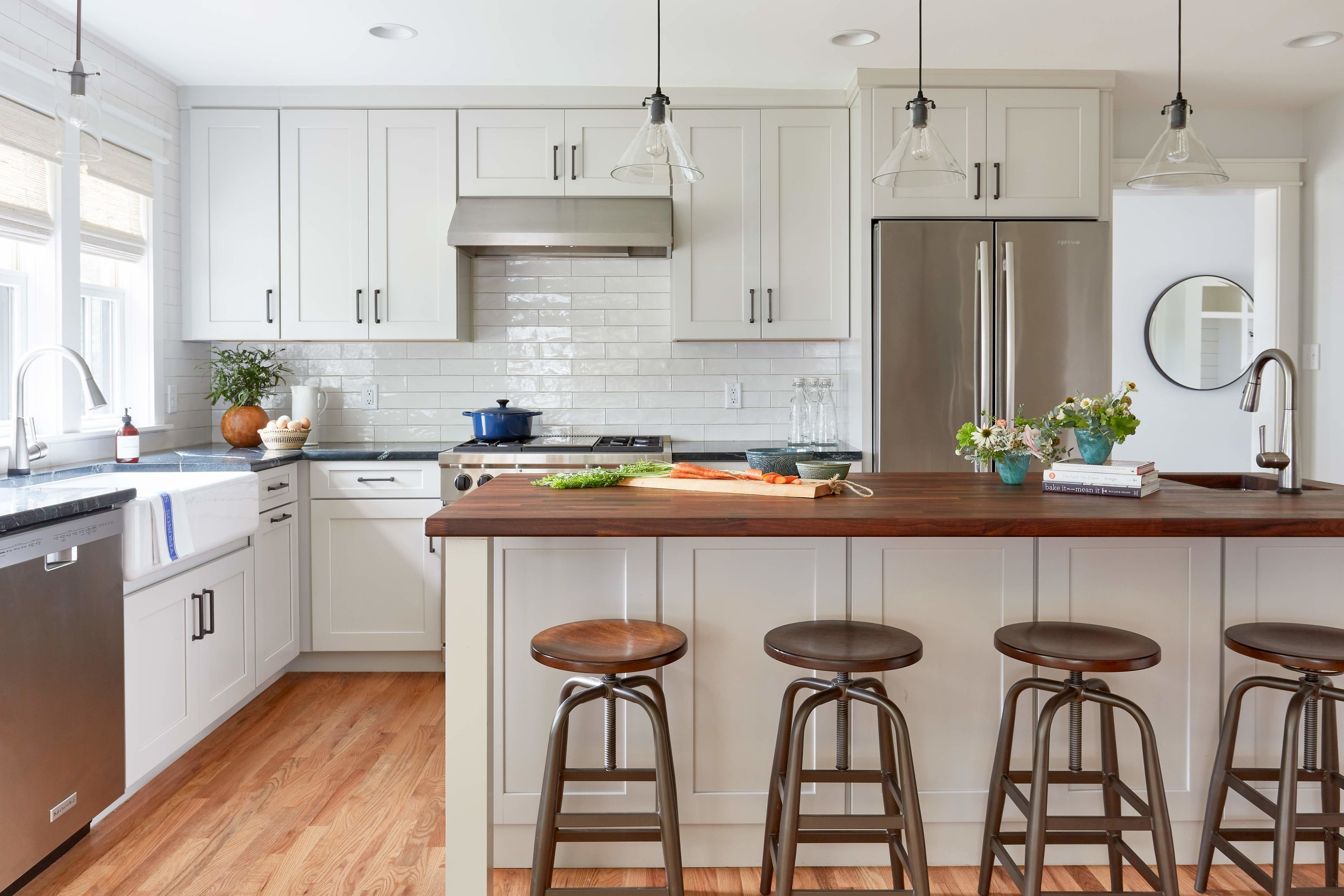 Renovated farmhouse kitchen with classic soapstone and walnut counters.
