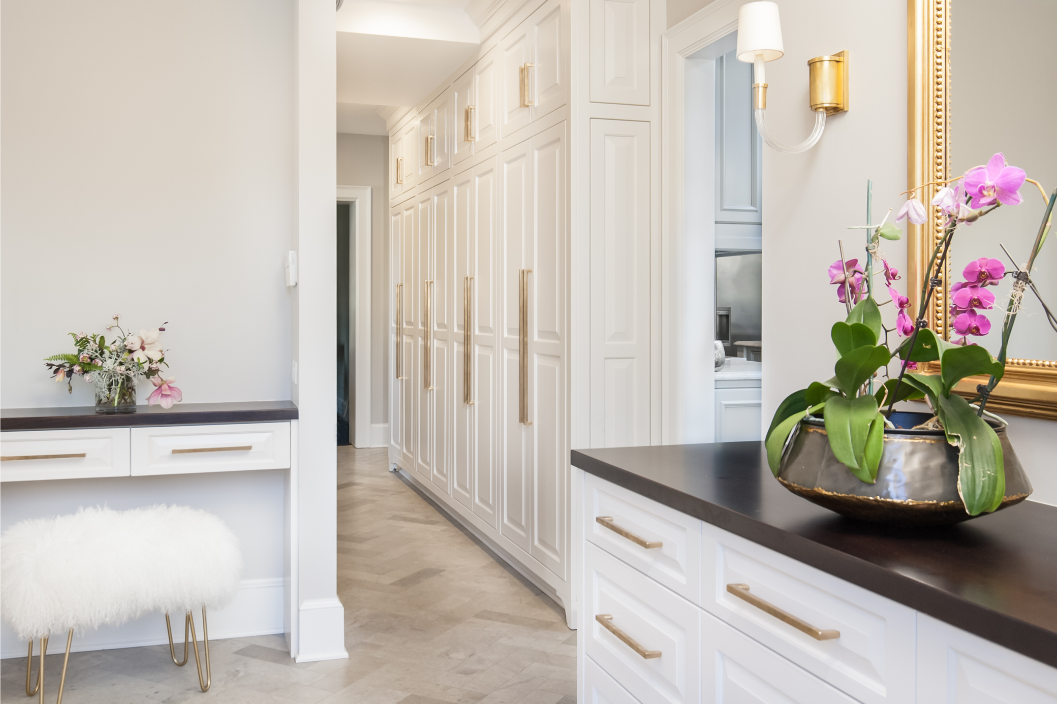 New cabinetry matching existing tall cabinets and new herringbone tile create a cohesive space.