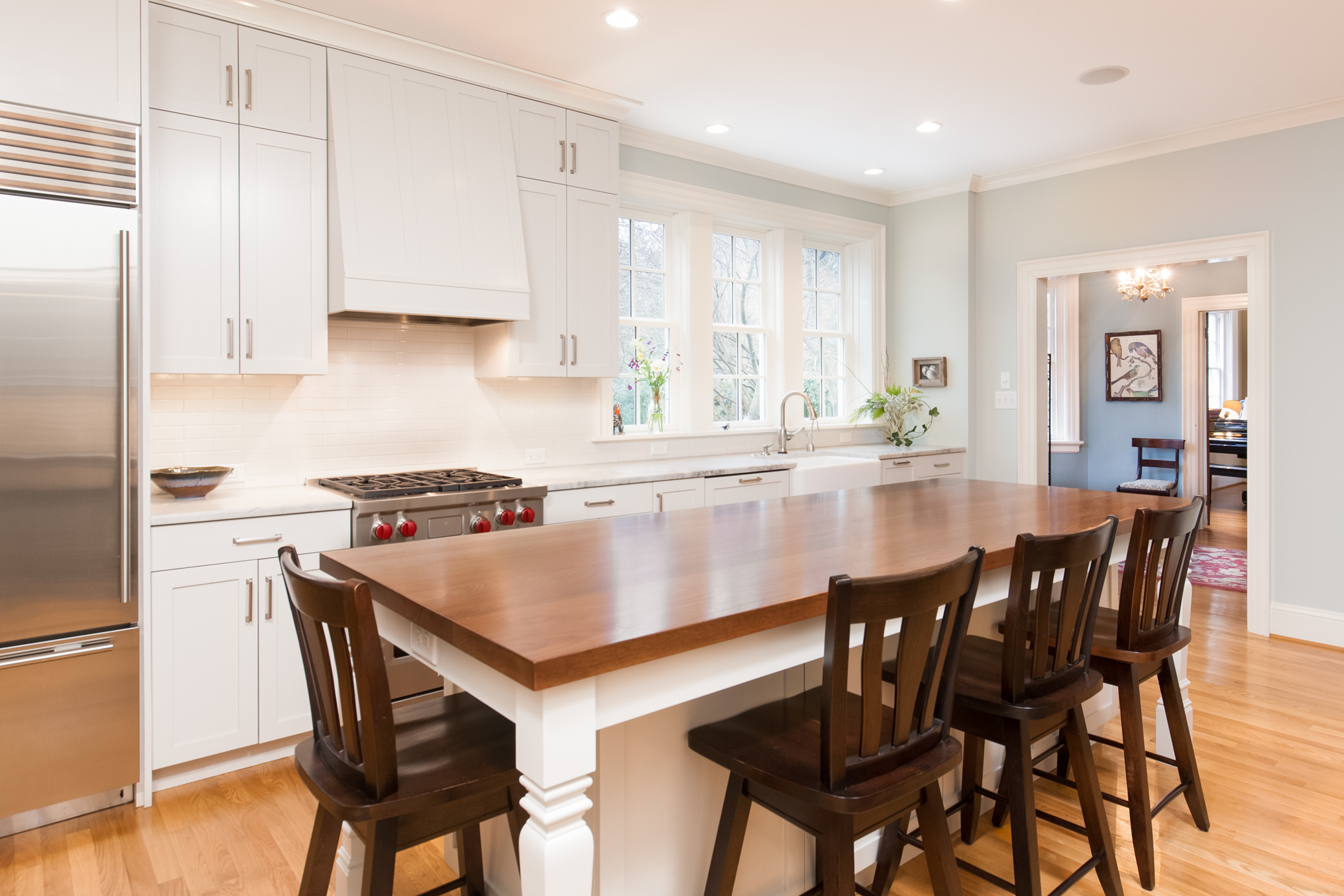 Large island with walnut top provides both work and gathering space.