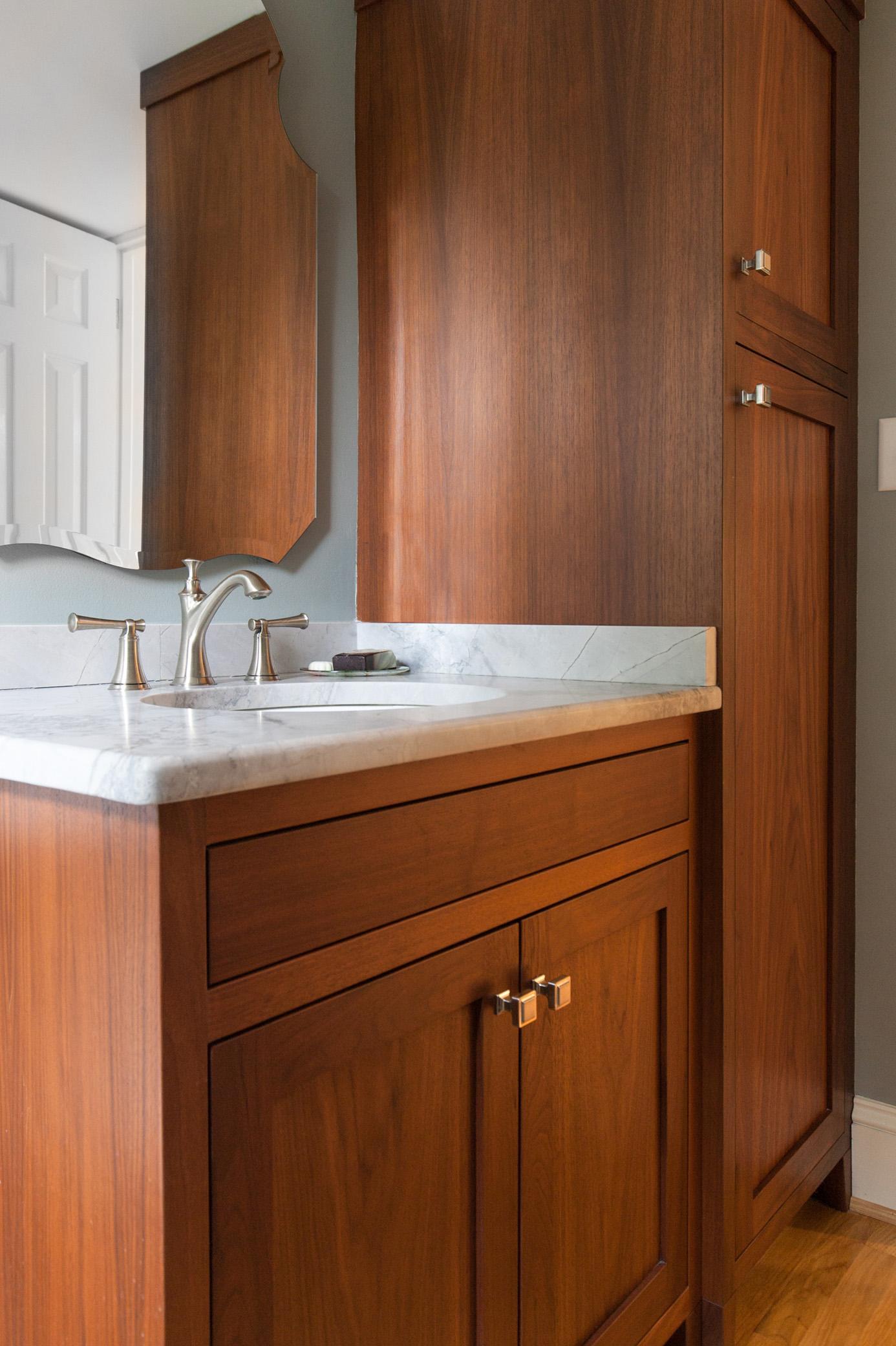 Custom walnut vanity in powder room.
