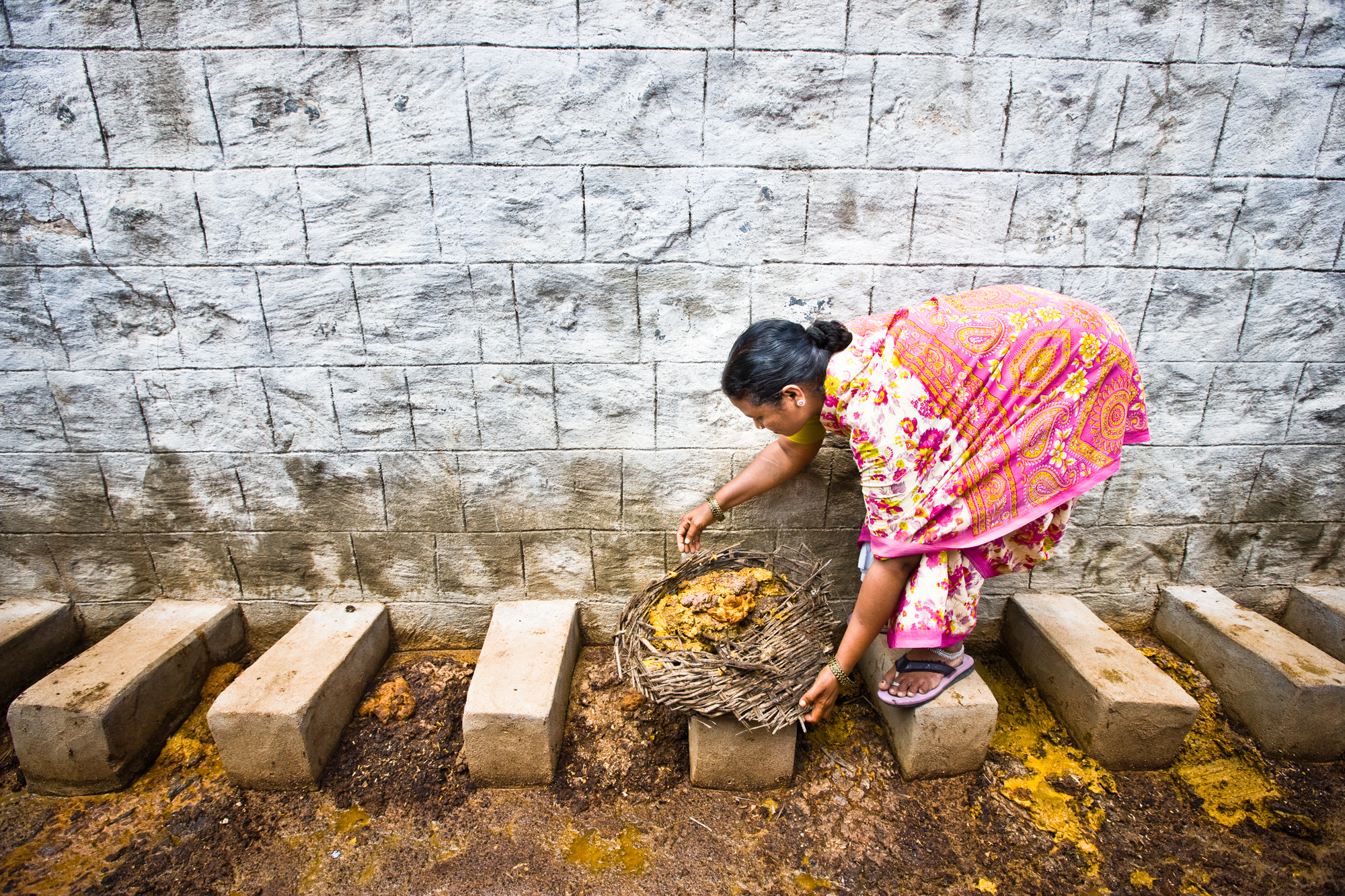 Every day, Uma walks through the village with her basket to the communal latrine. Nobody touches her along the way. She has an enamel toilet in her own home, but she cleans the excrement of others because this is the job assigned by her caste. This practice has been illegal since 1993, but still 700,000 Dalits, perhaps more, endure the same daily routine as Uma.  Kurnool District, Andhra Pradesh. Photo: Ecce Opus for CSW