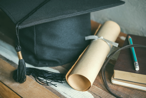 cap-with-degree-and-books-on-table.jpg
