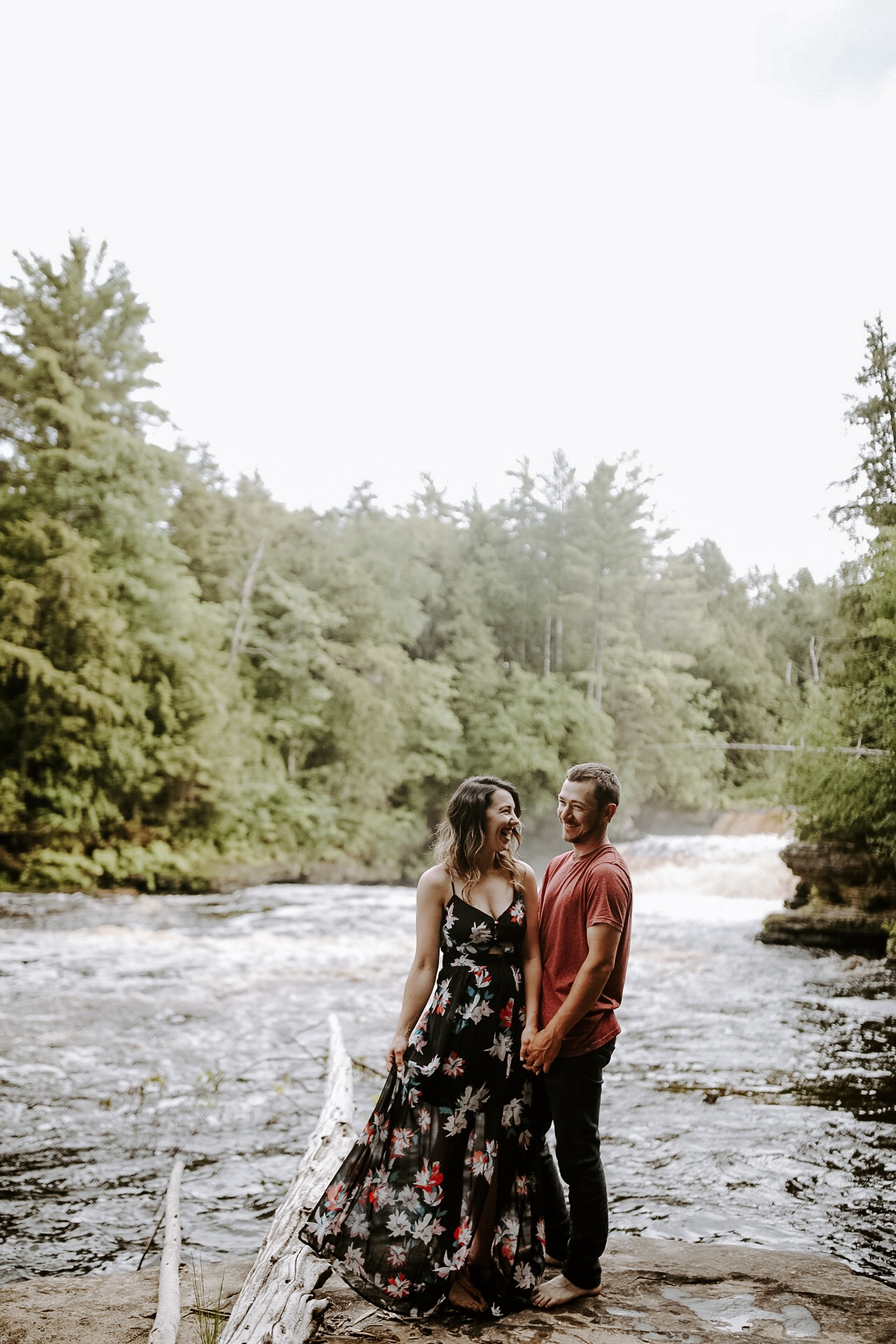 """Welcome Friends! - We're so excited you're here! We are Amanda & Richard- a husband & wife photography team. We call the Upper Peninsula of Michigan or 'the U.P."""" our home & we love getting to live in an area surrounded by so much natural beauty. We also jump at any chance to travel, so no matter where you are we'd love to work with you! When we're not taking pictures, you can find us spoiling our fur-baby Rocky, rewatching The Office on Netflix for the 29th time, trying new restaurants & breweries, or sitting around a bonfire.We've been shooting weddings together since 2012. We are passionate about capturing the 'real' moments. We want to create images that feel like you, images that you can look back on in 40 years & feel transported to the nervous energy before your first look, the swish of your dress on the dance floor, that speech that made you cry. We strive to show up & tell the truth.We also love getting to work with families & seniors! Our motto is the same for these sessions. Nothing is ever perfect- we are all about accepting where we are now & honoring that. Those moments with your new baby in the nursery or the stuffed animal you're kid refuses to go anywhere without won't last. We get excited about capturing the real, the raw, the messy parts of this beautiful life.We'd love to hear more about you, click the Contact button at the top to get in touch!*photo by the talented Steph Pickard"""