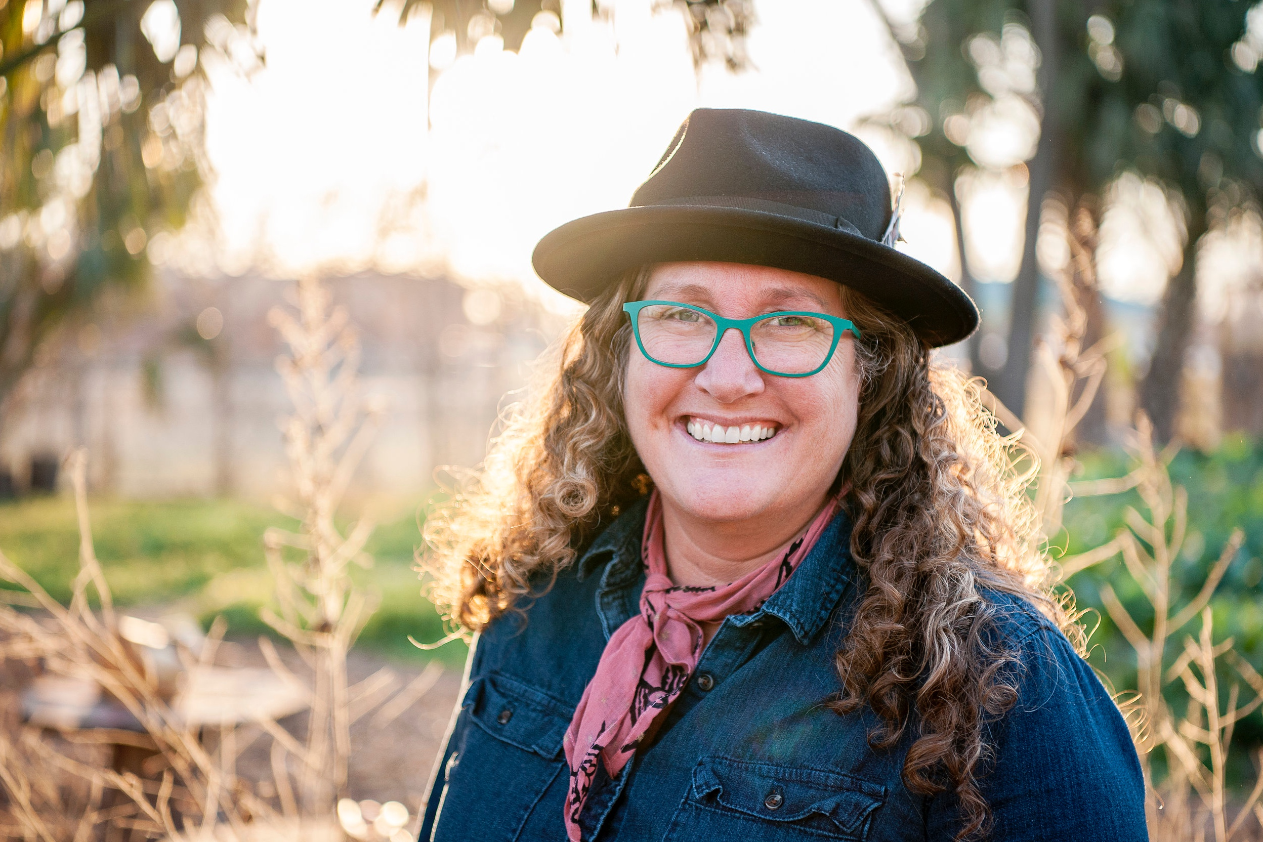 Stephanie Scherzer   Stephanie Scherzer is a passionate advocate for local food systems and a committed steward of community and land resources. An urban farmer for over two decades, she founded Farmhouse Delivery in 2009 to connect consumers with sustainably-raised local produce and grow the market for goods from local producers. Over the decade since its founding, Farmhouse Delivery has created deep ties with over 180 unique farmers/ranchers/artisan food purveyors, employed over 75 community members at fair-wage salaries, and purchased over 500 tons of locally-raised produce, meat, and artisanal food produc annually. As she forged new distribution systems for local food, she also helped implement experimental agricultural projects to benefit local communities, including a pomegranate farm in West Texas and a humane pig farm. In 2018, she joined the staff of Lettuce Grow, a direct-to-consumer hydroponic growing system with a mission to allow everyone to grow their own healthy food at home. In addition to her career experience in horticulture and small-scale urban farming, she is a co-founder of the East Austin Urban Farm Tour, which has raised over 100k for the Farm and Ranch Freedom Alliance, and has served on the board of Urban Roots and is a member of the Growers' Alliance of Central Texas.
