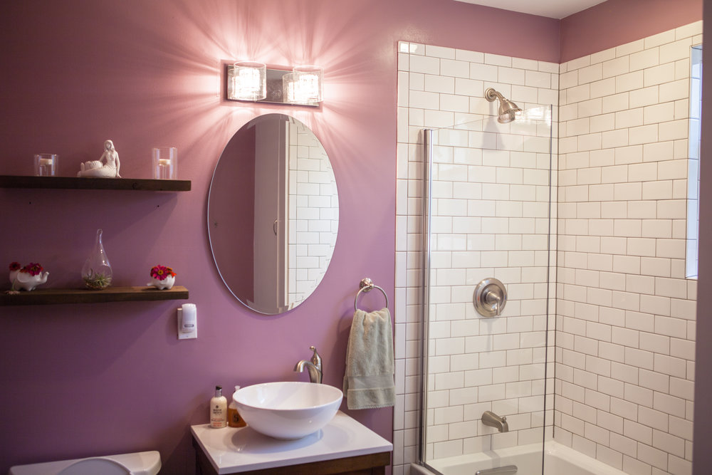 Pretty in Pink - Wow, what an improvement!  Floor to ceiling subway tile in the shower, a new gleaming deep tub and new vanity featuring a ceramic vessel sink.