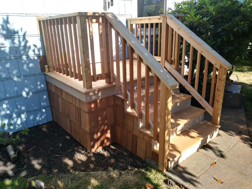 Cedar Shake Landing & Stairs - From shabby to chic, this landing and stairs remodel included a full demo and re-build.  Finished with cedar shake siding, for an authentic PNW look.