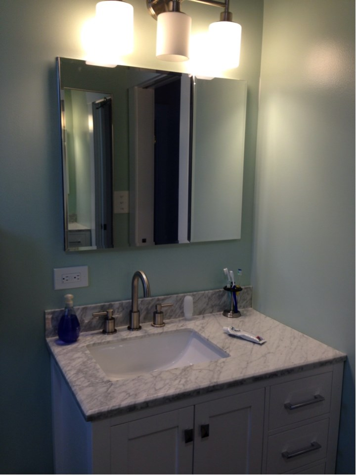 From One Bathroom to Two! - What an awesome project to be a part of - from one vintage, master bathroom to an updated master bath and guest bath.  We demoed the master bath & hallway closet and created two beautiful bathrooms.  Both bathrooms feature granite counter tops, pocket doors and vinyl planking flooring.  Beautiful!