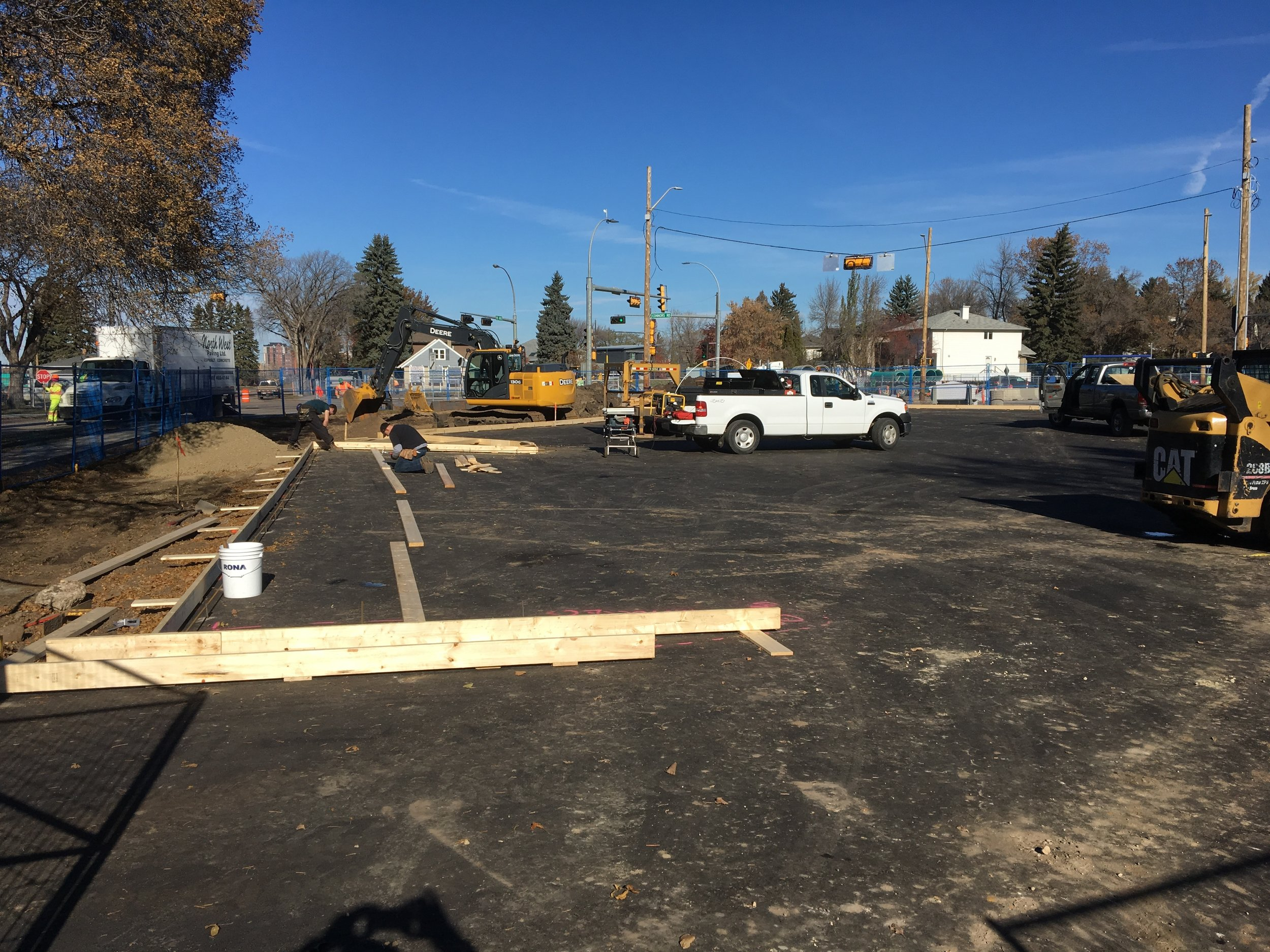 Connors Hill: the triangular parking lot has been resurfaced. Workers are preparing for the curb installation.