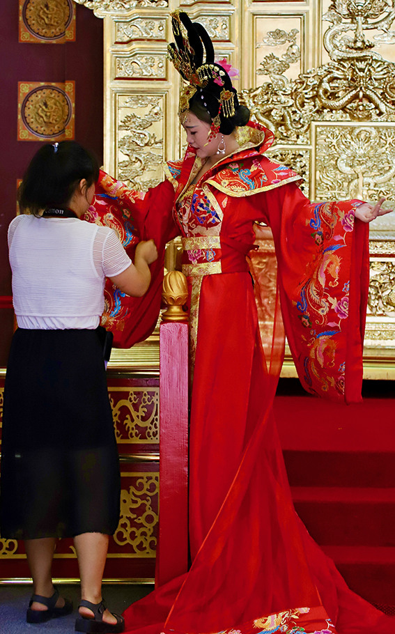 Stallholders outside the museum complex give tourists the chance to dress up like an emperor or empress for a day.