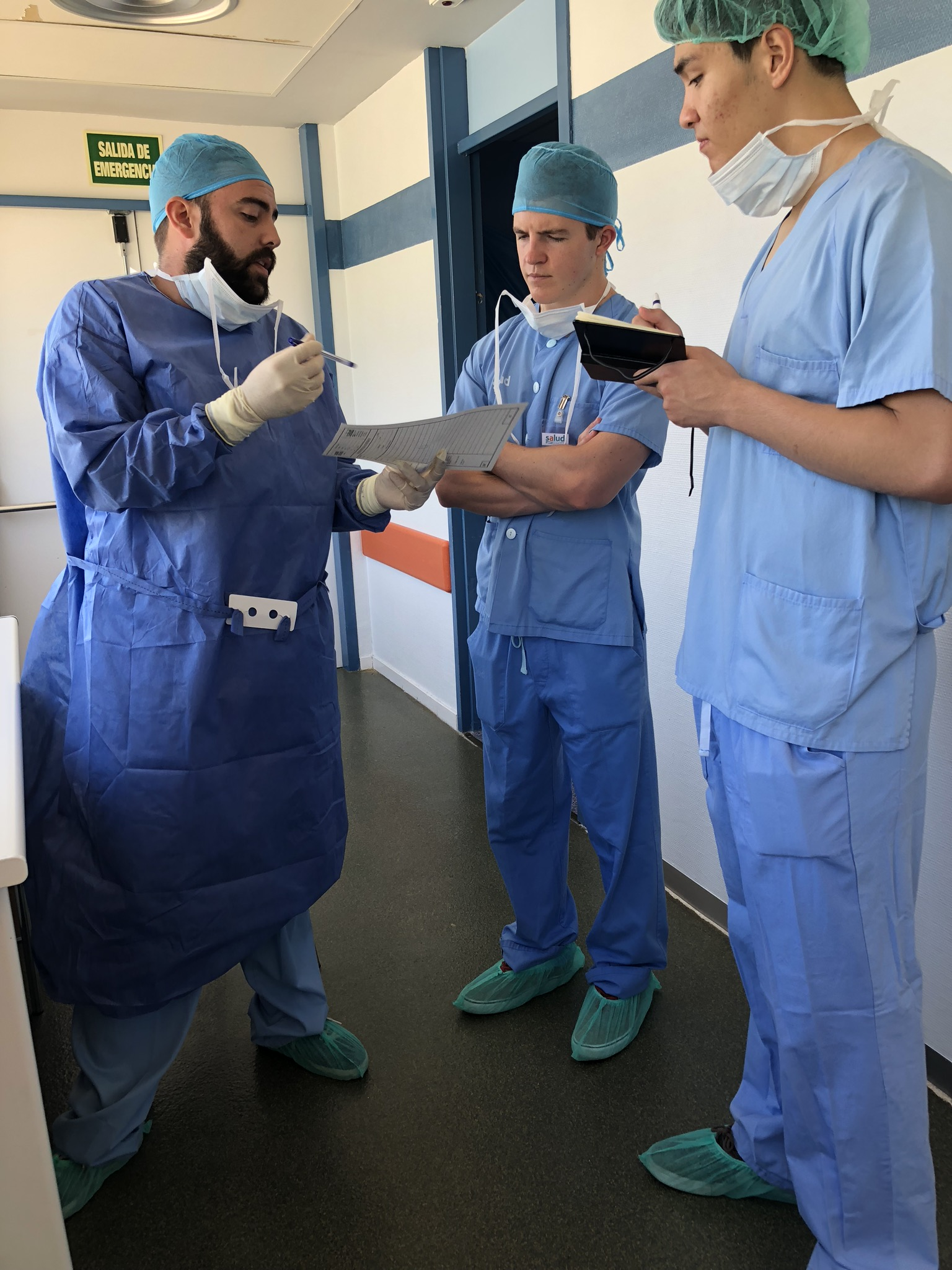 Atlantis Fellows take notes before shadowing in the OR, Hospital San Jorge, Huesca, Spain 2018