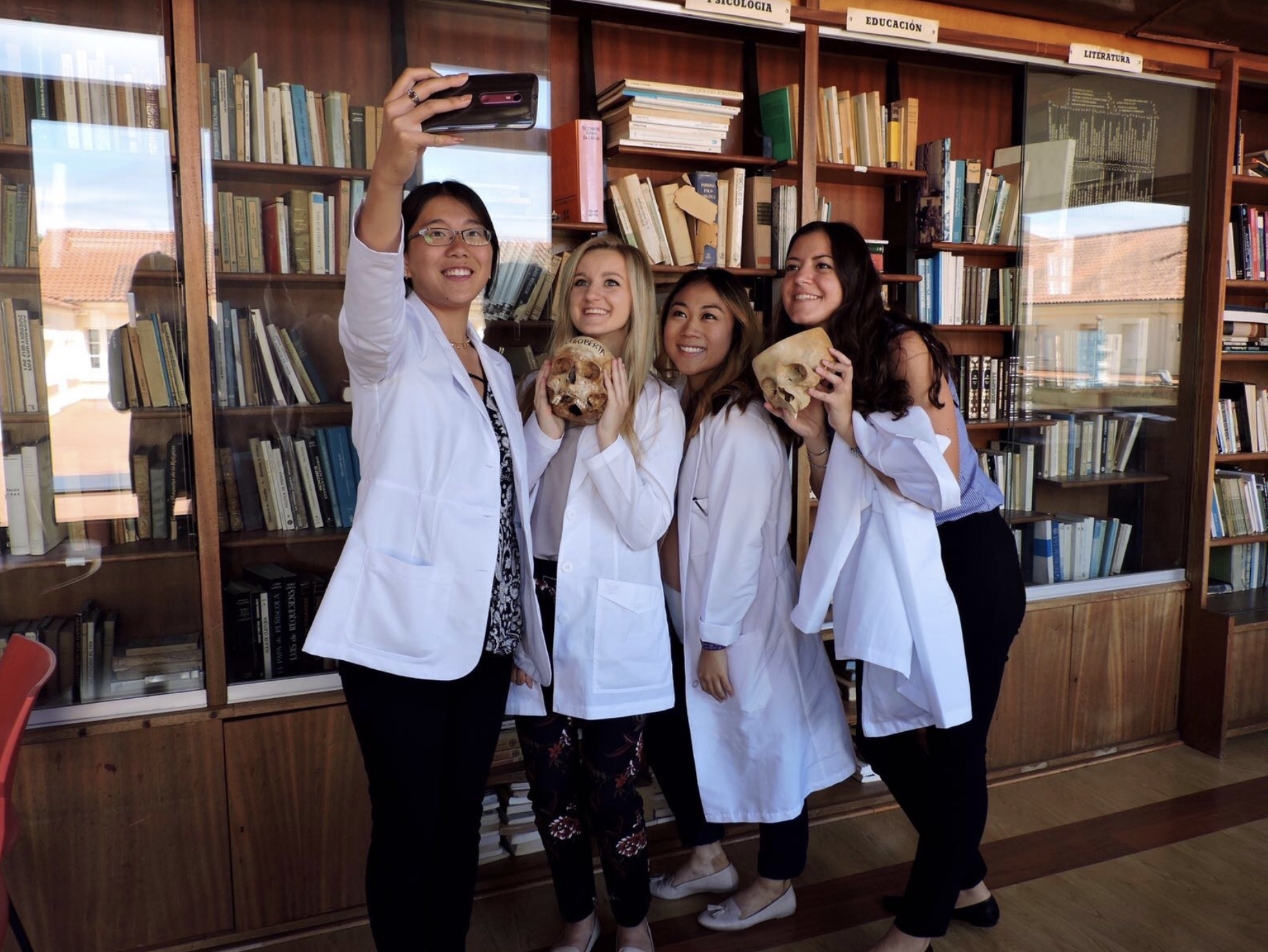 Us taking a silly picture in Santiago with some of the skulls in the library.